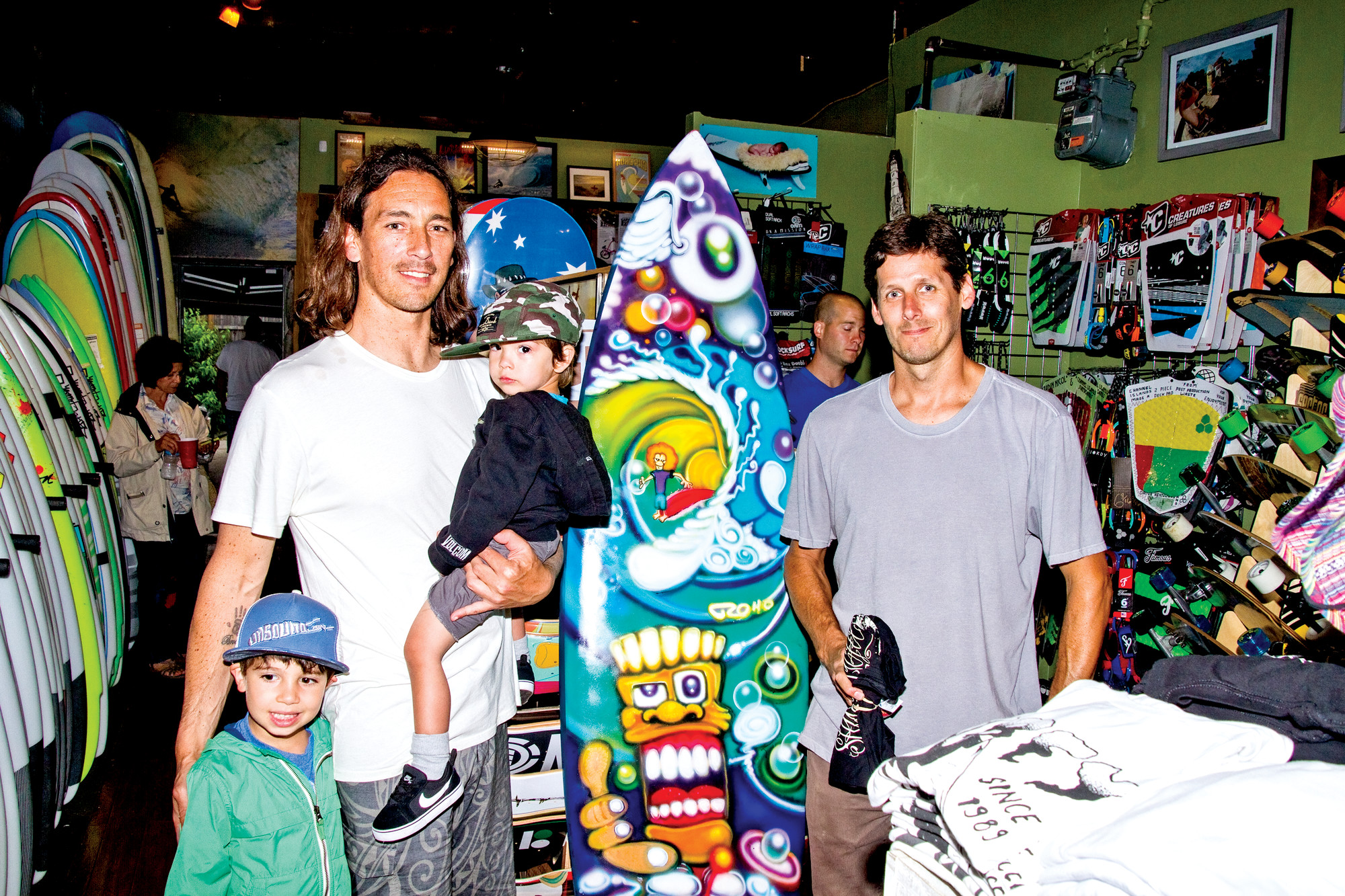 Unsound co-owner Dave Juan, left, with his kids, Brody and Dane, and co-owner Mike Nelson at Unsound's art show in June. Juan and Nelson worked to bring the Quiksilver event to town — and fought to salvage the competition after it was nearly canceled in the wake of Tropical Storm Irene.