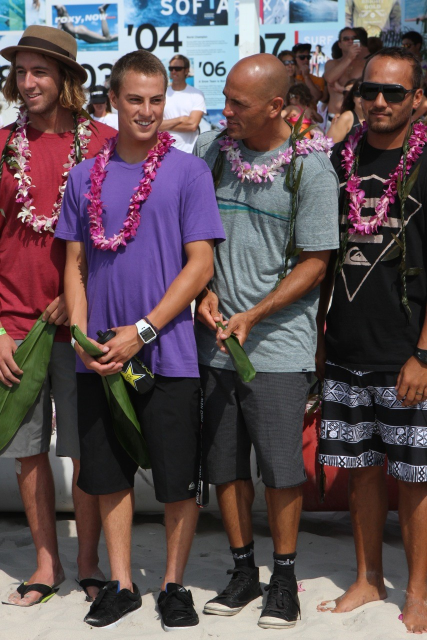 Pro surfers Balaram Stack, second from left, Kelly Slater and Freddy Patacchia during the opening ceremony of the competition. 