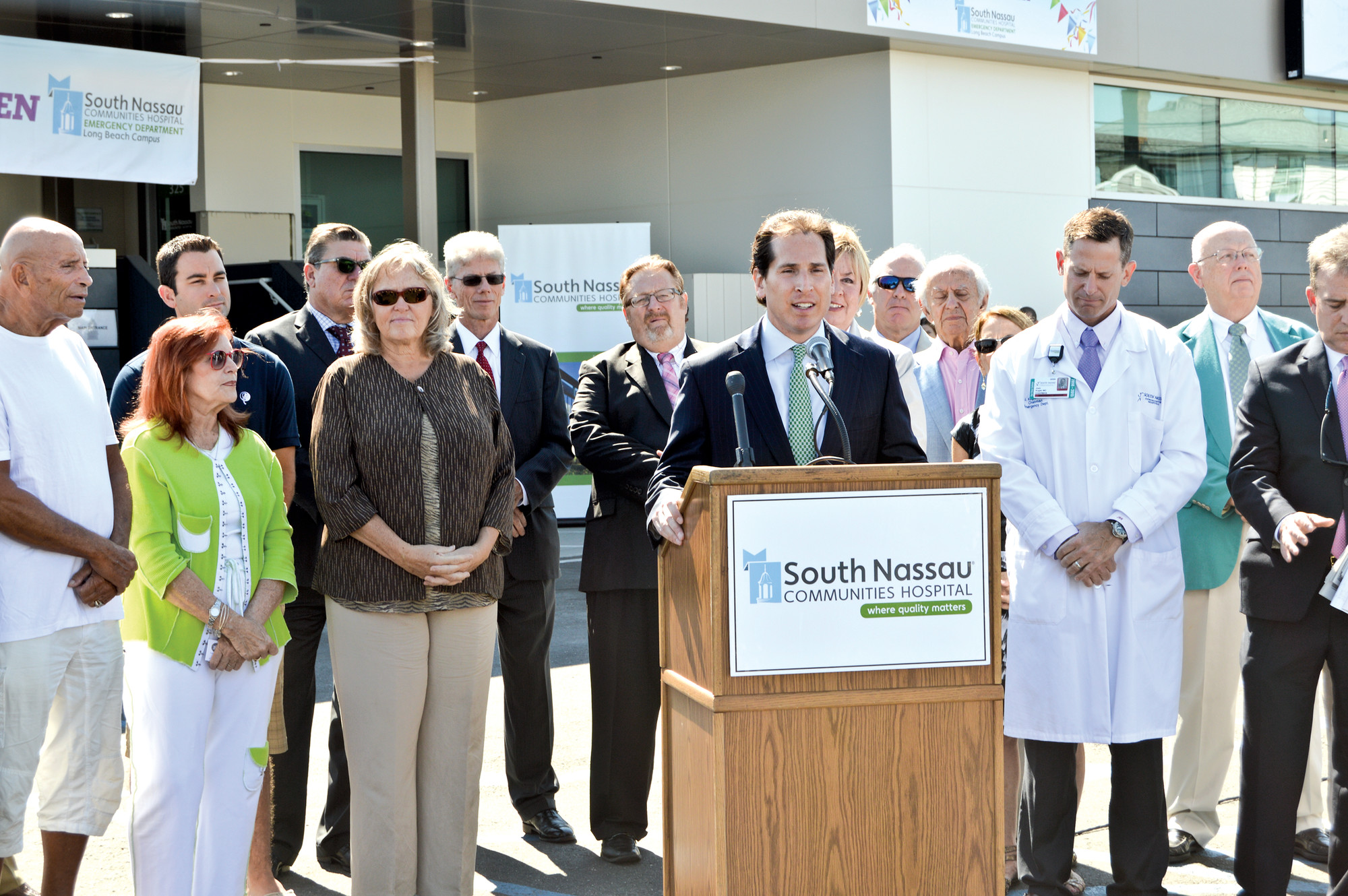 State Assemblyman Todd Kaminsky, at podium, County Legislator Denise Ford, third from left, and other officials spoke at the ribbon-cutting ceremony.