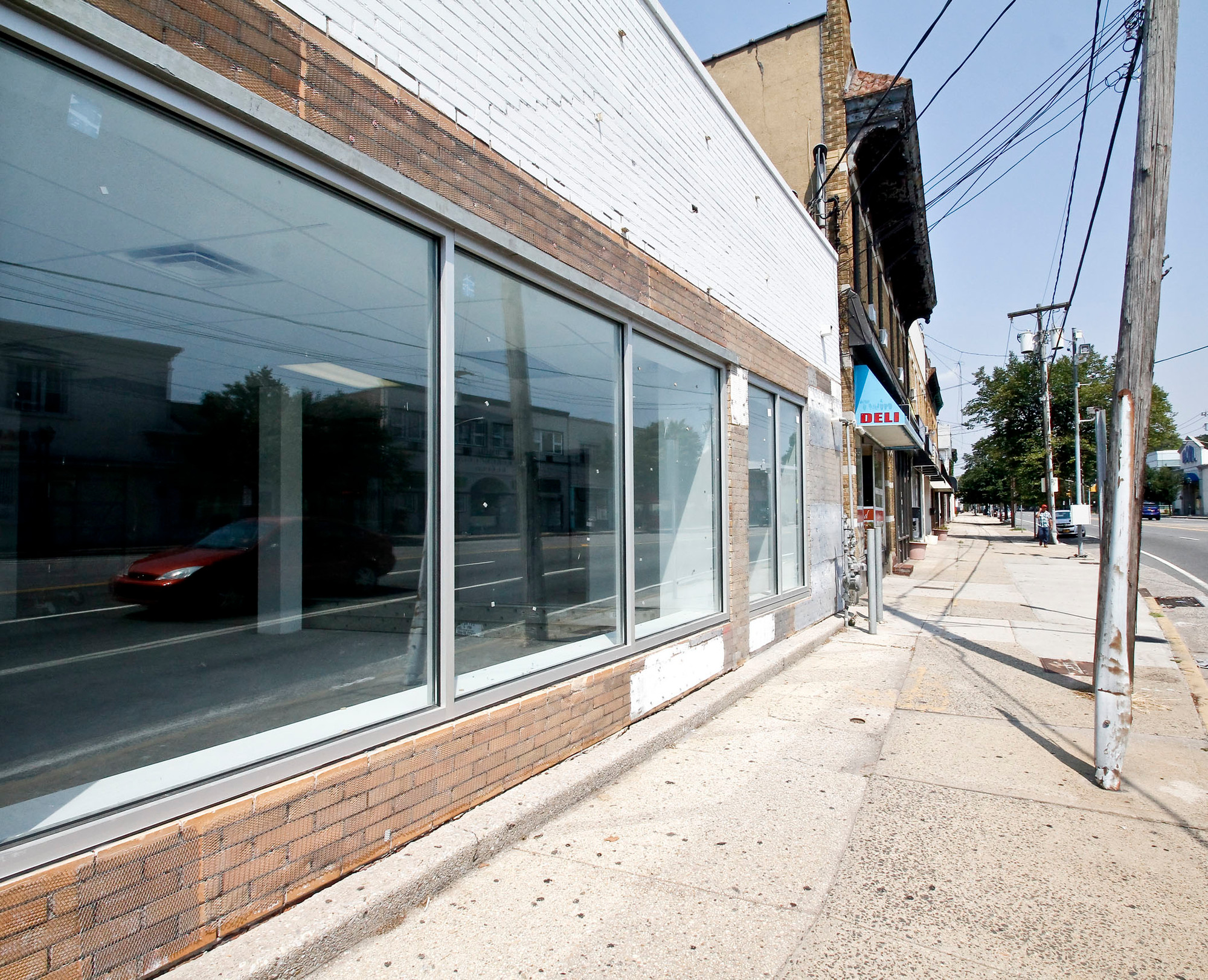 Many storefronts on busy Grand Avenue at Merrick Road remain empty while planners search for a developer to rehabilitate the site.
