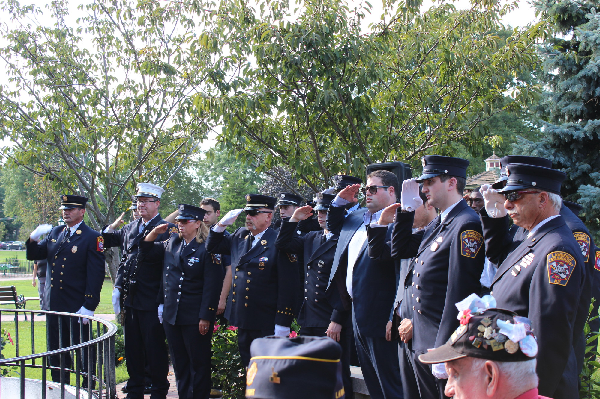 The Lawrence-Cedarhurst Fire Department raised their right hands to salute those who lost their lives on 9/11.