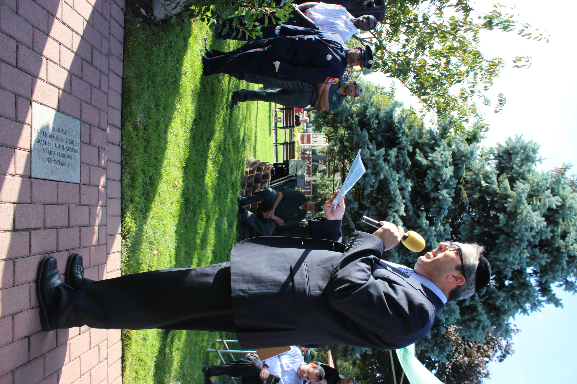 Village of Cedarhurst Trustee Israel Wasser read a memorial granite marker during the 9/11 ceremony held at Andrew J. Parise Park in Cedarhurst on Sept. 11.