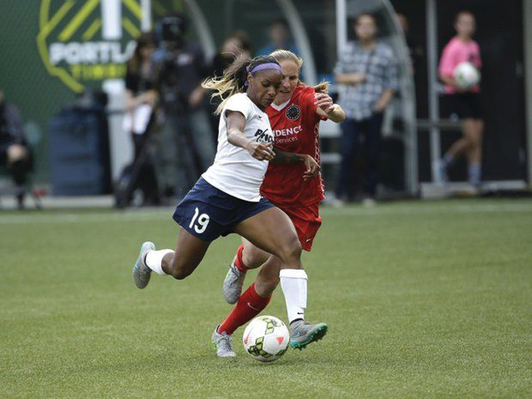 Crystal Dunn, left, being marked by the Portland Thorns' Rachel Van Hollebeke. Dunn was named the NWSL's MVP for 2015.
