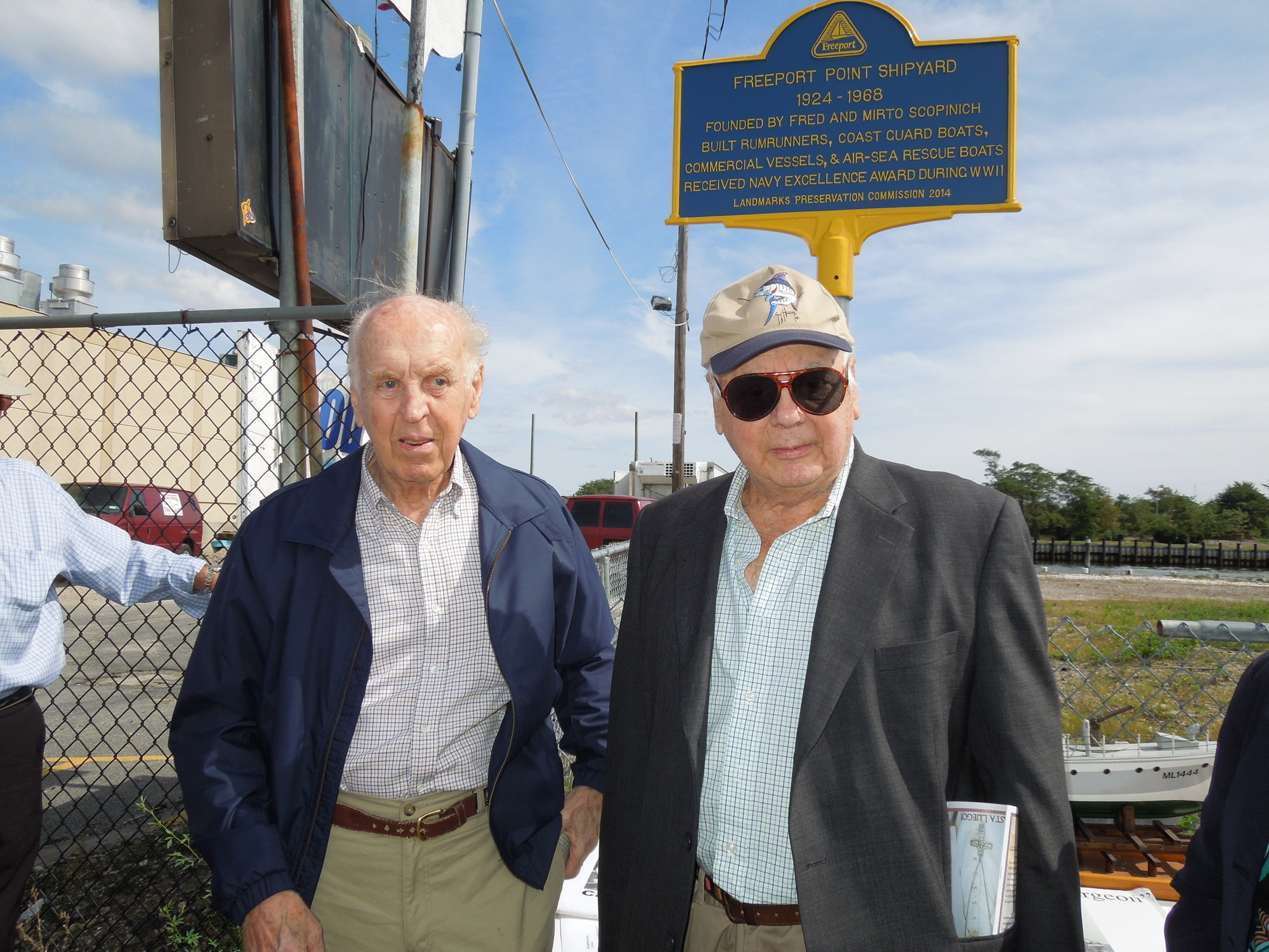 Mario and fred Scopinich unveil a marker that honors the Freeport Point Shipyard, founded by their family.