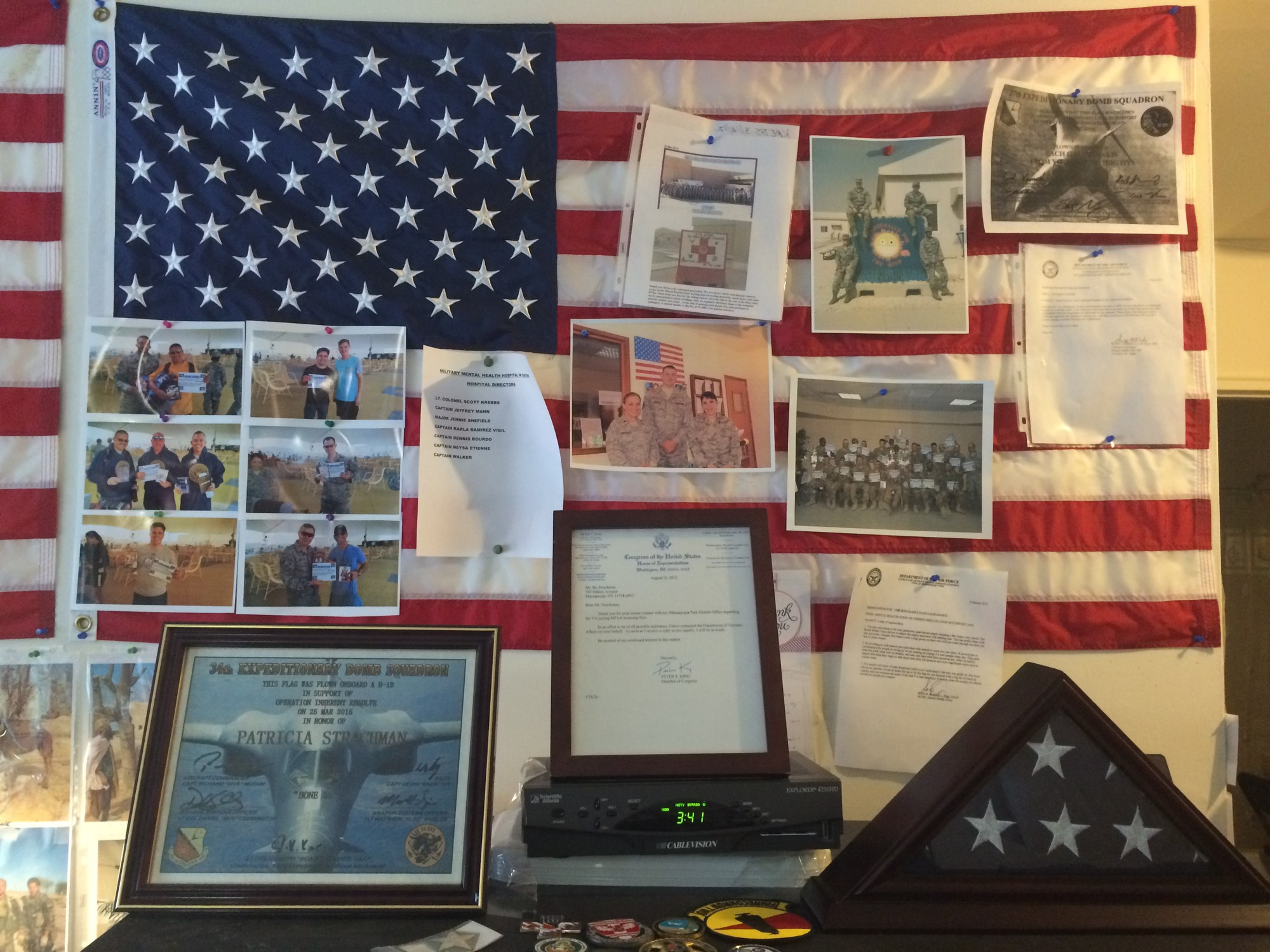 Strachman's Massapequa apartment features numerous photographs and other mementos from his time serving in the army. He is a World War II veteran.