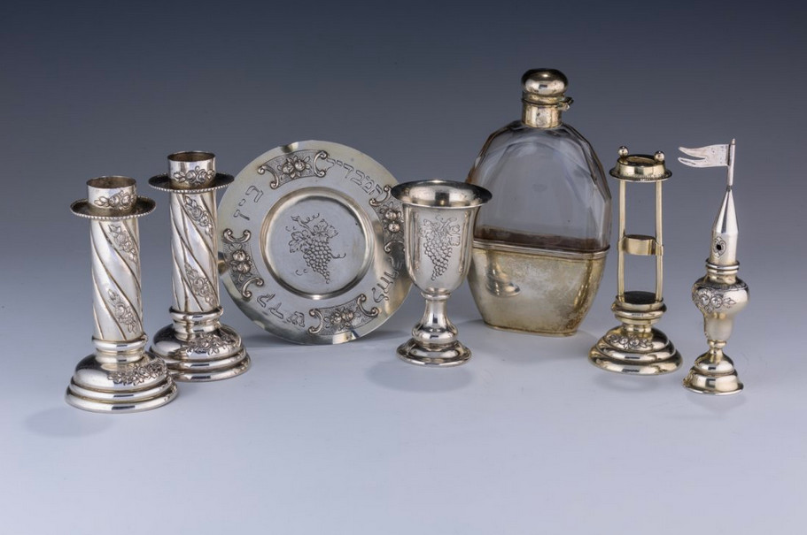 An 1880 traveling Sabbath set with candlesticks and Kiddush cup will be auctioned at J. Greenstein & Co., Inc. It is from the collection of Jakob Michael, a lifelong collector of Jewish ritual art.