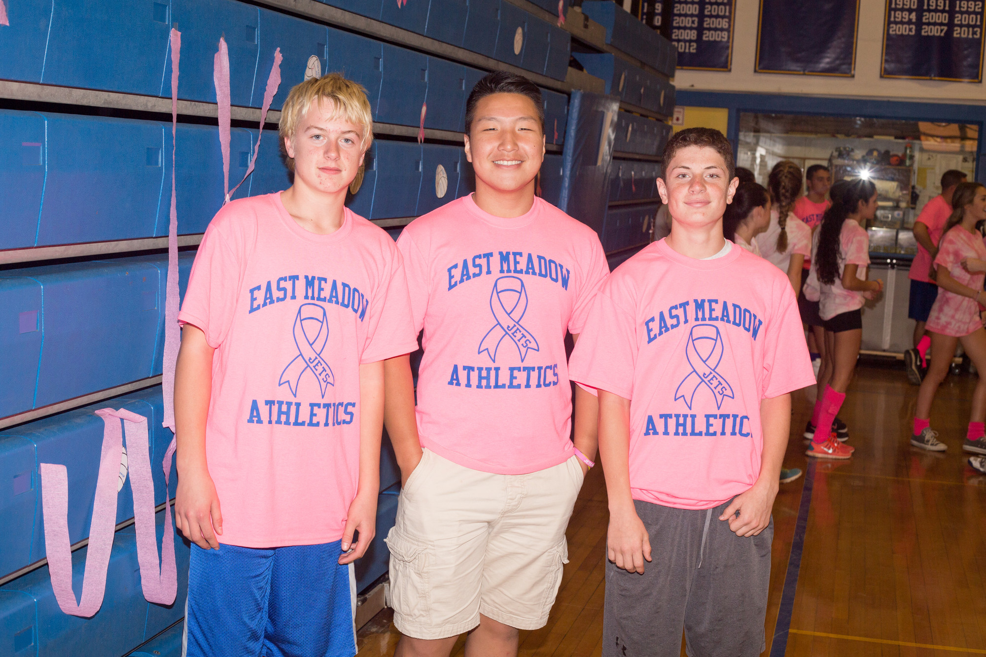 Chris Keegan, Zi Zheng, and Tyler McManus, left to right, of East Meadow's junior varsity football team.