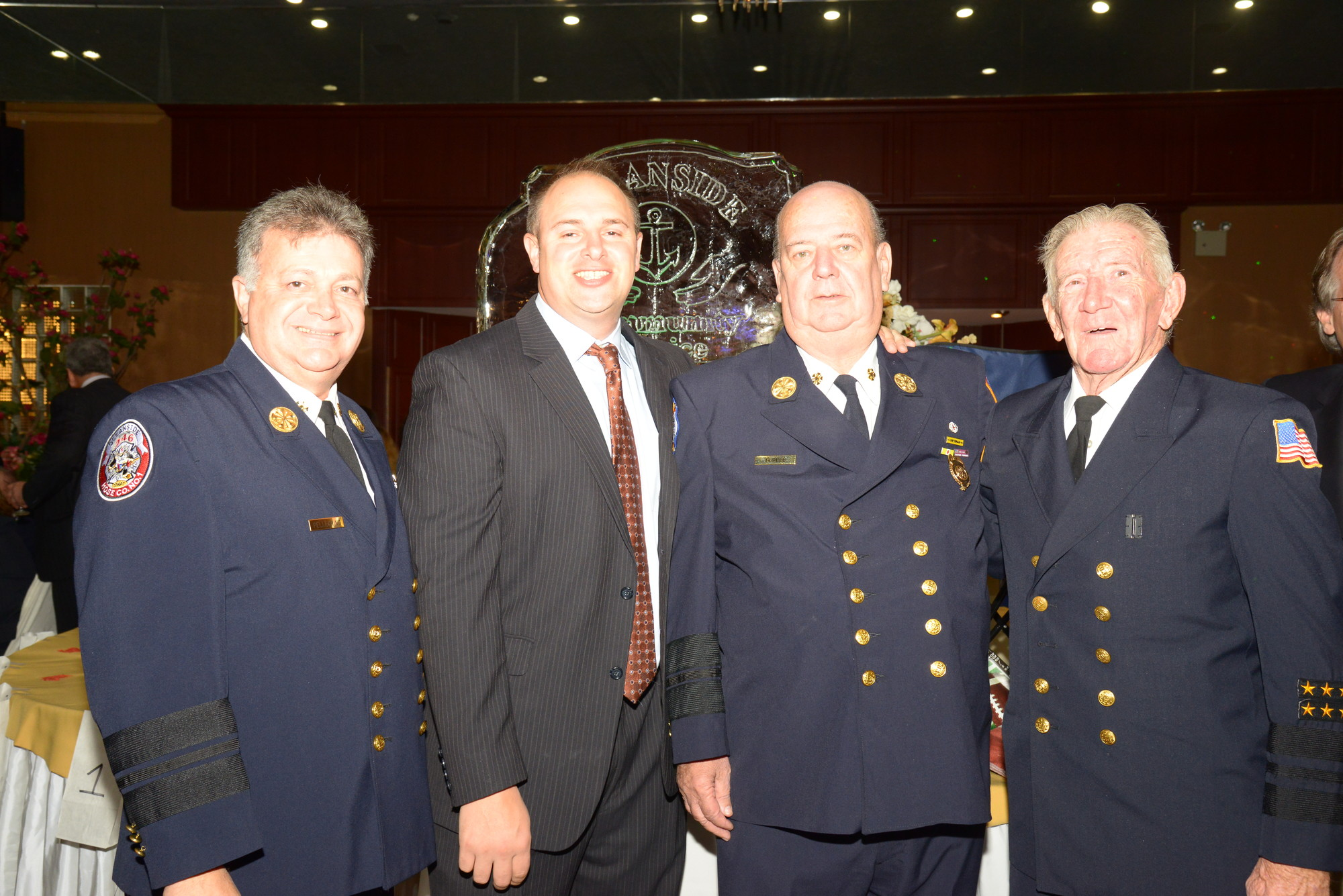 Showing their support, Chief Thomas Pellegrino, far left, Frank Criscuolo, Chief Richard Bedell and Chief Red Robertson of the Oceanside Fire Department attended the Oceanside Community Service's annual fundraiser.