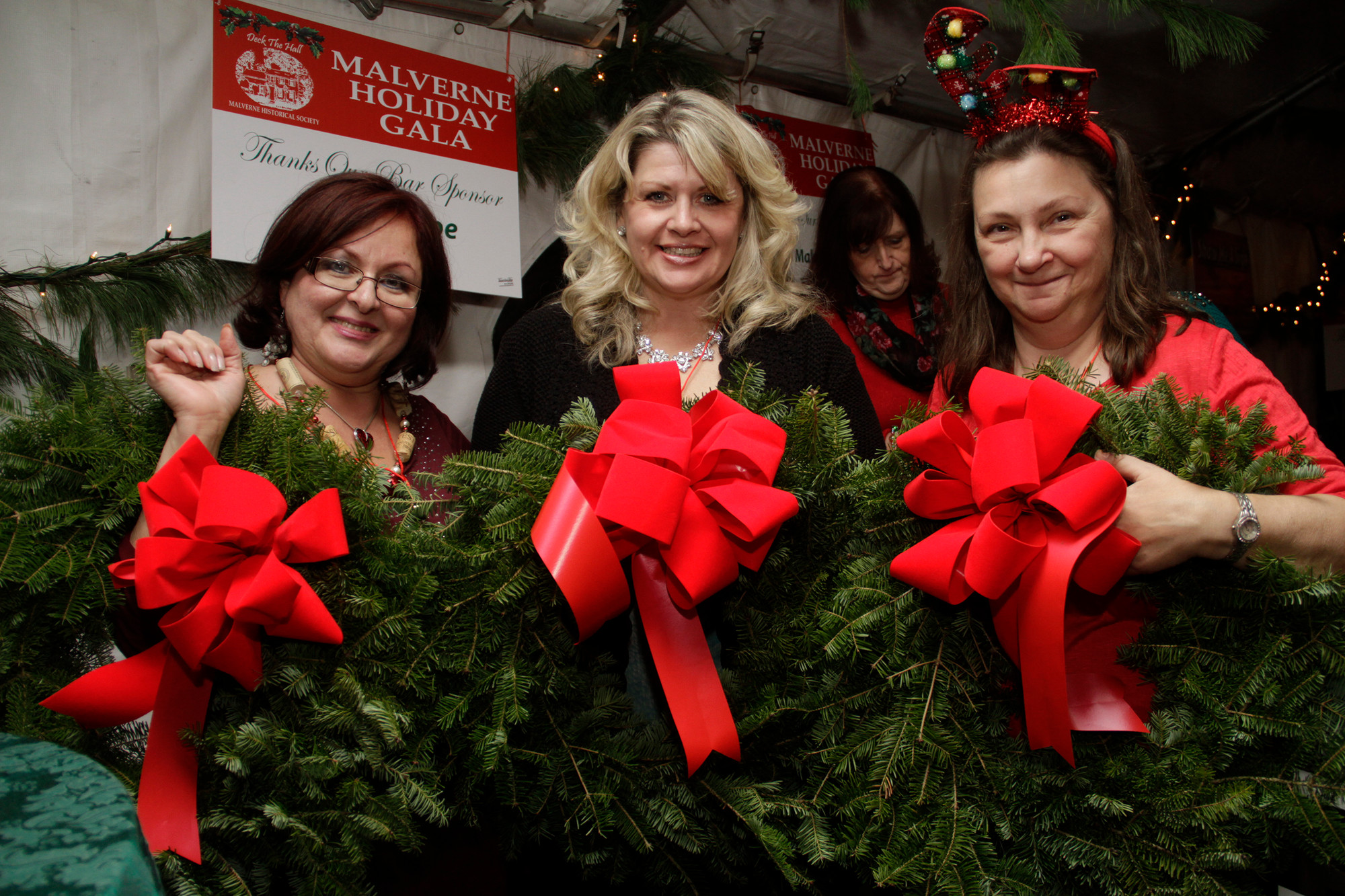 Liz Berger, Alison Lorch and Laurie Lerner, winners of a holiday wreath door prize at the Malverne Historical Society's Holiday Gala.