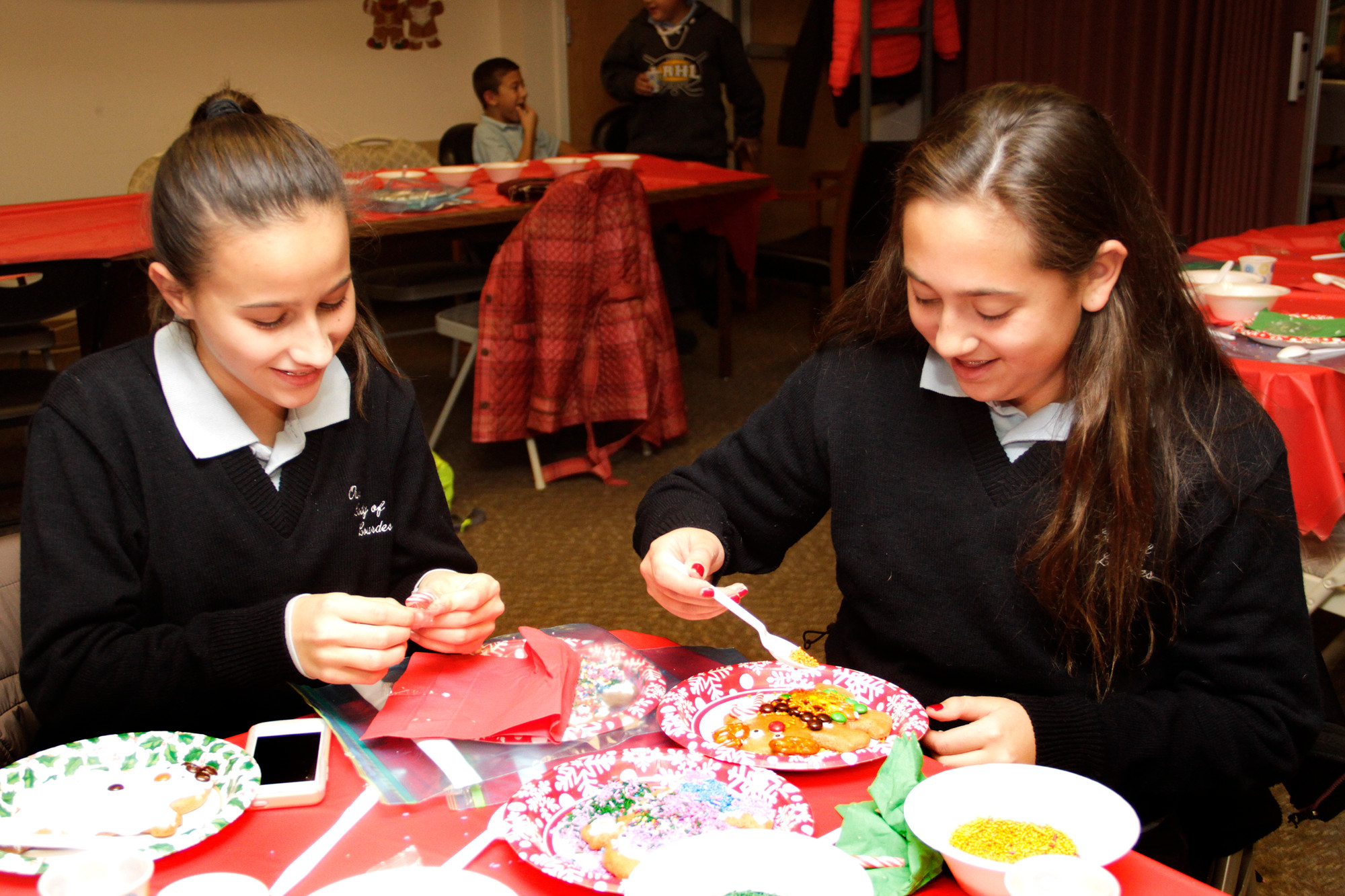 You're never too old to decorate a ginger bread man. Briana Niedermyer and Ashley Grech decorated theirs.
