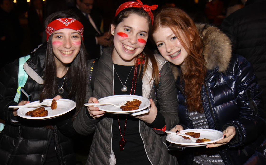 HAFTR High School sophomores Gabriella Stein, Erica Hilsenrath and Leora Gershkovich with latkes at the dedication ceremony.