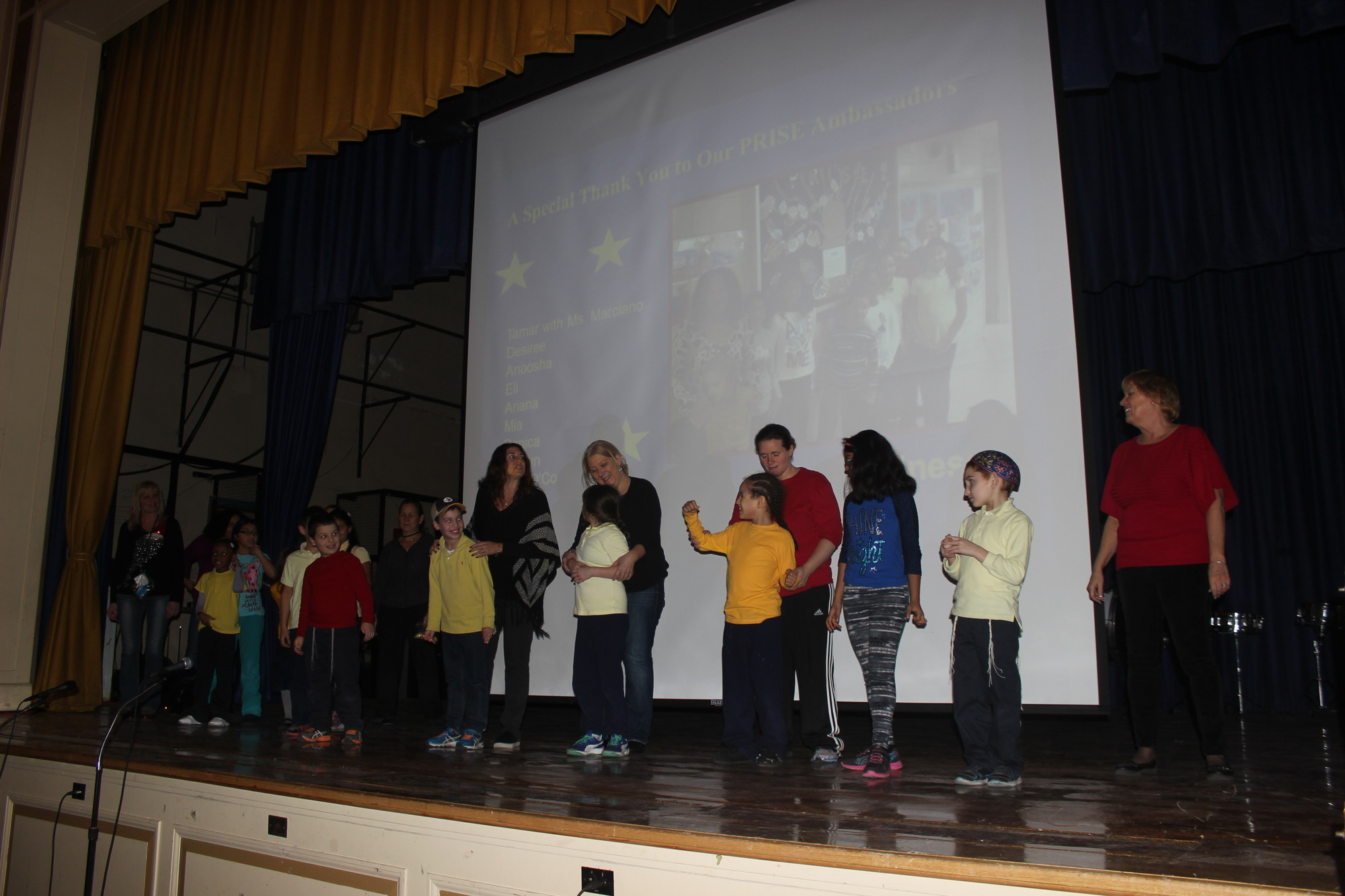 Lawrence Elementary School's PRISE ambassadors and students sang at the character education assembly on Dec. 23.