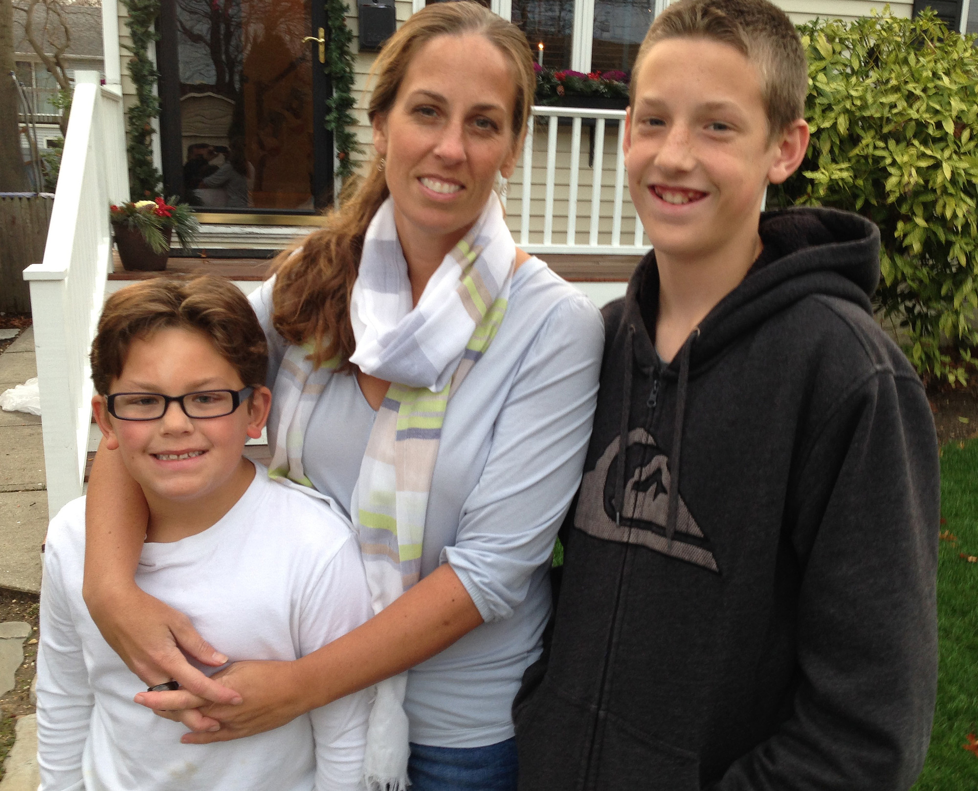 For all that Jeanette Deutermann has done to reform New York's education system, she is the Bellmore Herald Life's 2015 Person of the Year. She is joined here by her sons, Jack, left, and Tyler.