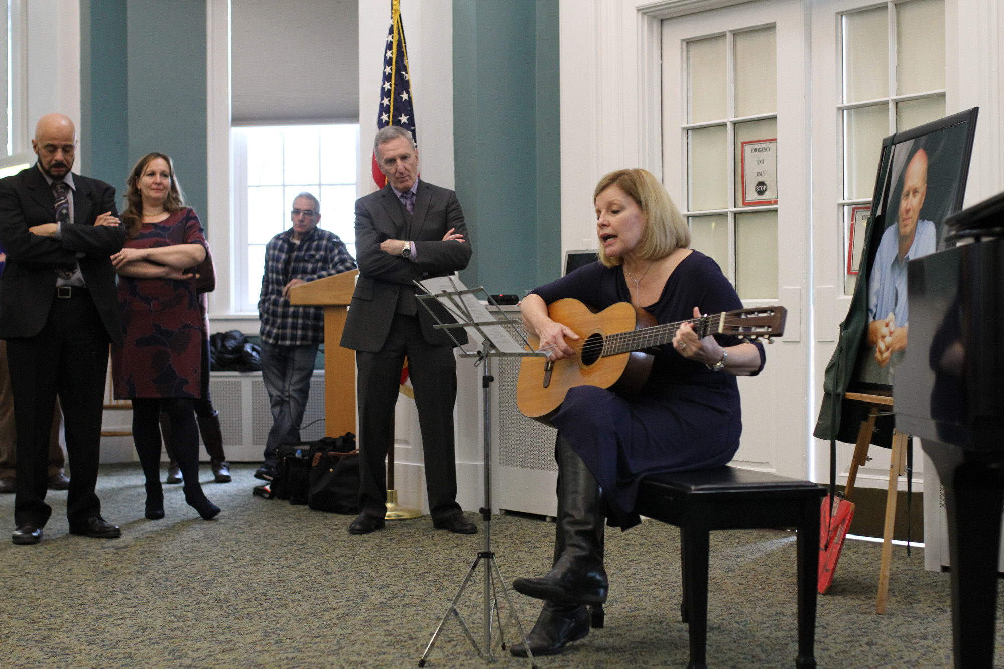 Kerry Koehler, a retired East Rockaway High School teacher and a friend of Bishop's for over 30 years, performed an original song in memory of her late friend.