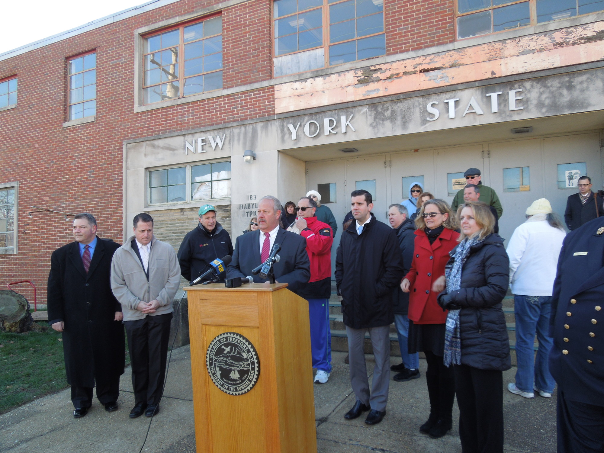 Mayor Robert Kennedy, at lectern, was joined by local and state officials on Jan. 11 to urge the governor to transfer the armory to the village for use by the Department of Public Works