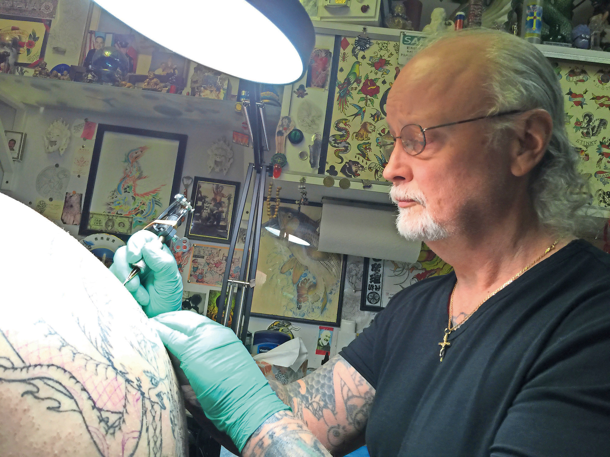 Richie Montgomery took over Long Island Tattoo from Peter Poulos in 1975. He has since renamed the business and moved it east on Hempstead Turnpike twice — once in 1986 and then in 1997, to 1548 Hempstead Turnpike, where he has been ever since