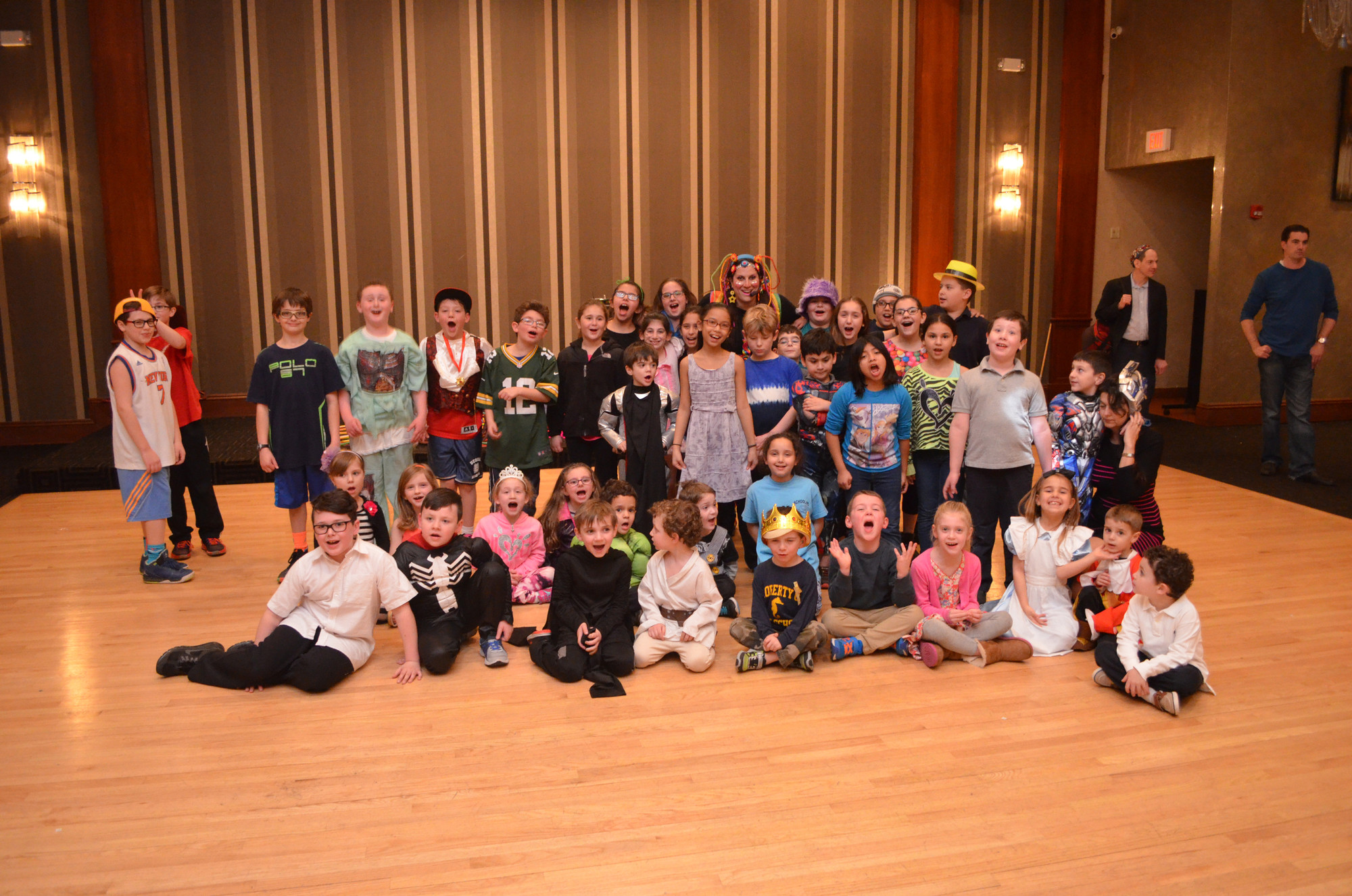 All of the children posed for a photo in the costumes that they wore for Purim.