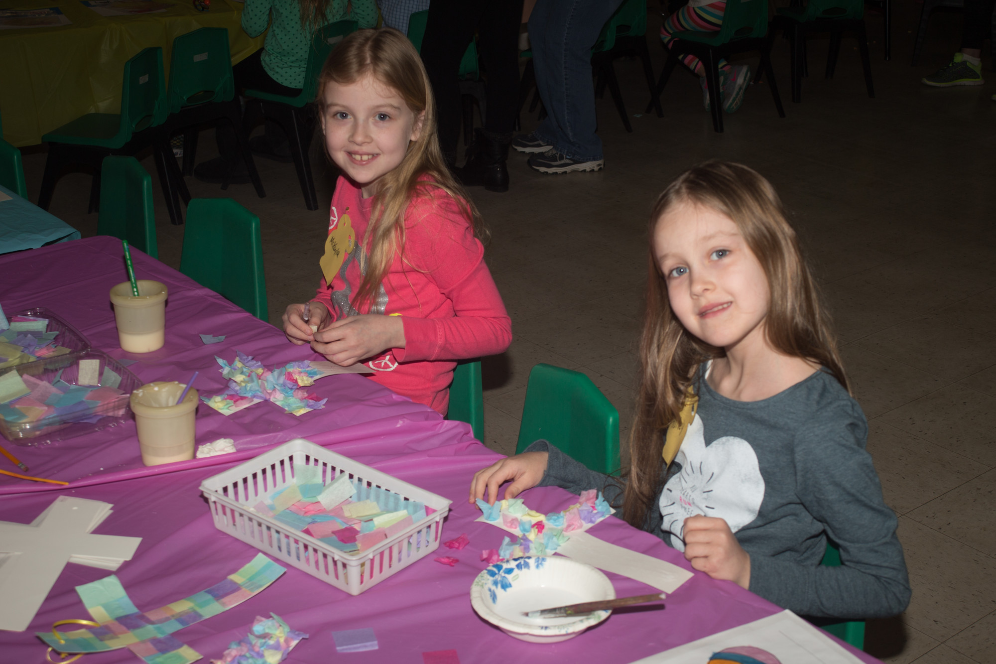 At the Easter party, Mckayla, 9, and Haily, 7, decorated crosses.