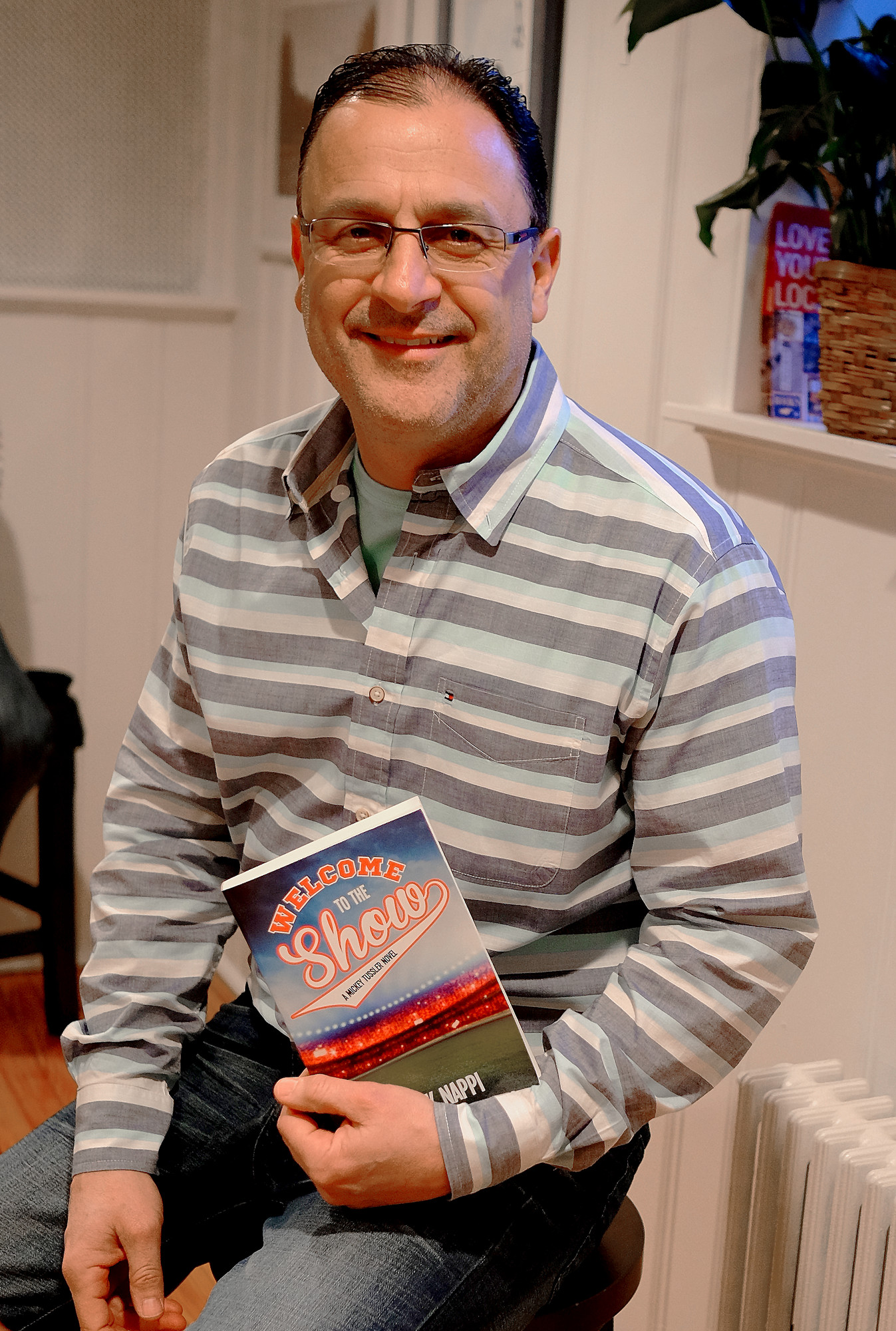 "Frank Nappi showed off ""Welcome to the Show"" the latest book in his Mickey Tussler series, at Turn of the Corkscrew."