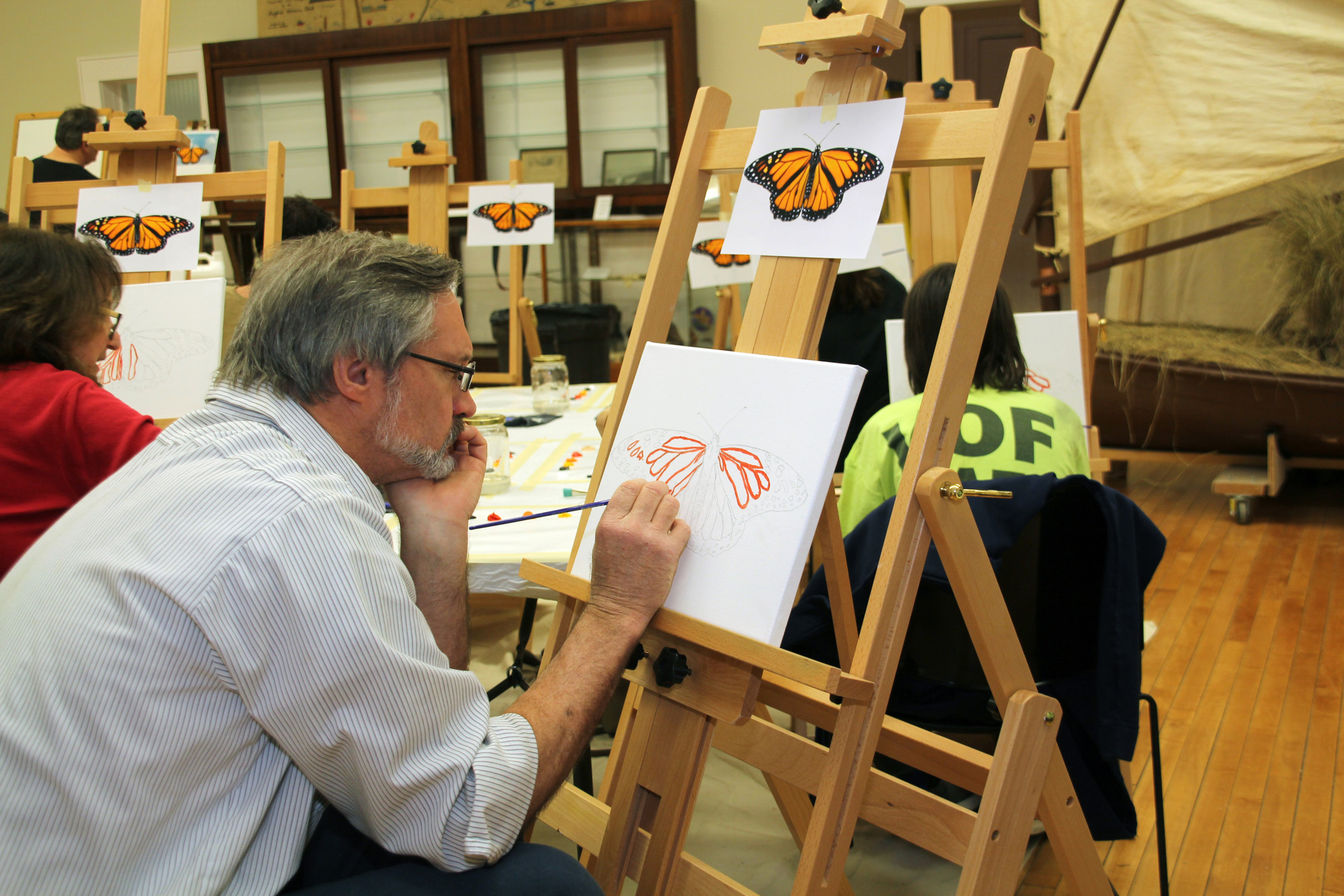 Mark Wurthmahn worked on his butterfly piece at Paint Night at the Museum on April 15, hosted by the Seaford Historical Society.