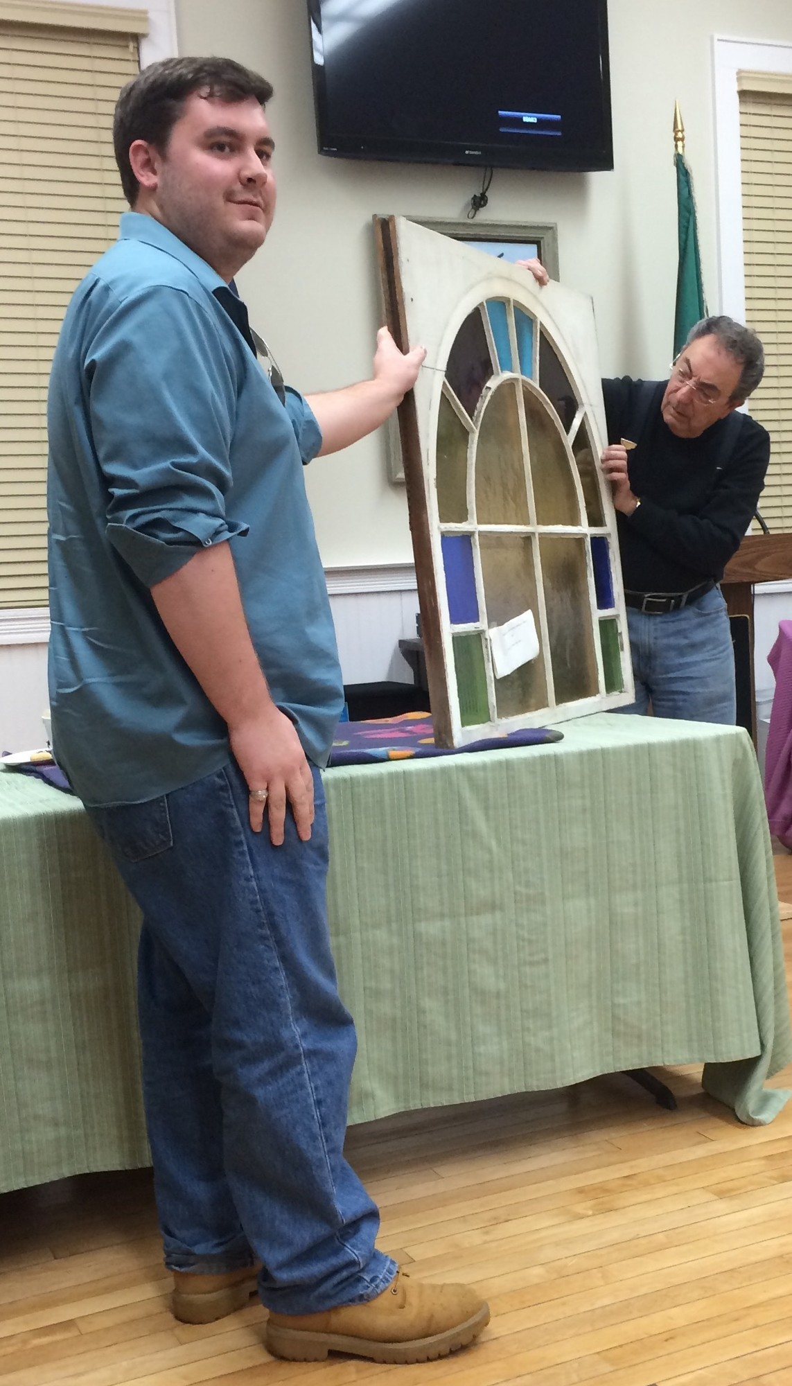 Historical Society board member Patrick Martz, left, showed Costello a stained glass window that was from the original Methodist Church building on Merrick Road.