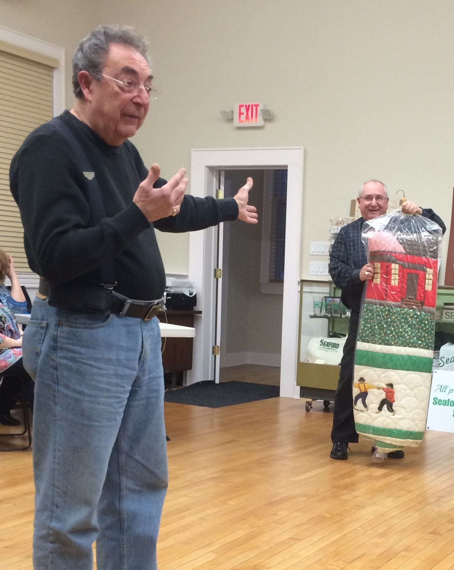 Steve Bongiovi, right, showed Eddie Costello a quilt from the 1960s that Costello valued at $12,000.