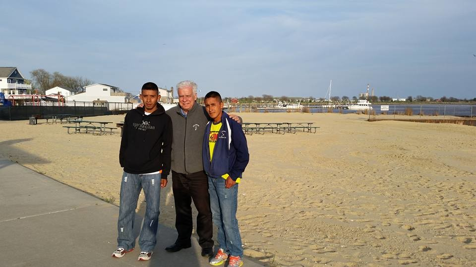 ERick Chavez Chox, left, and his brother, Wilson, saw the ocean for the first time last week when they visited Hewlett Point Beach with St. Raymond's Deacon Rich LaRossa.