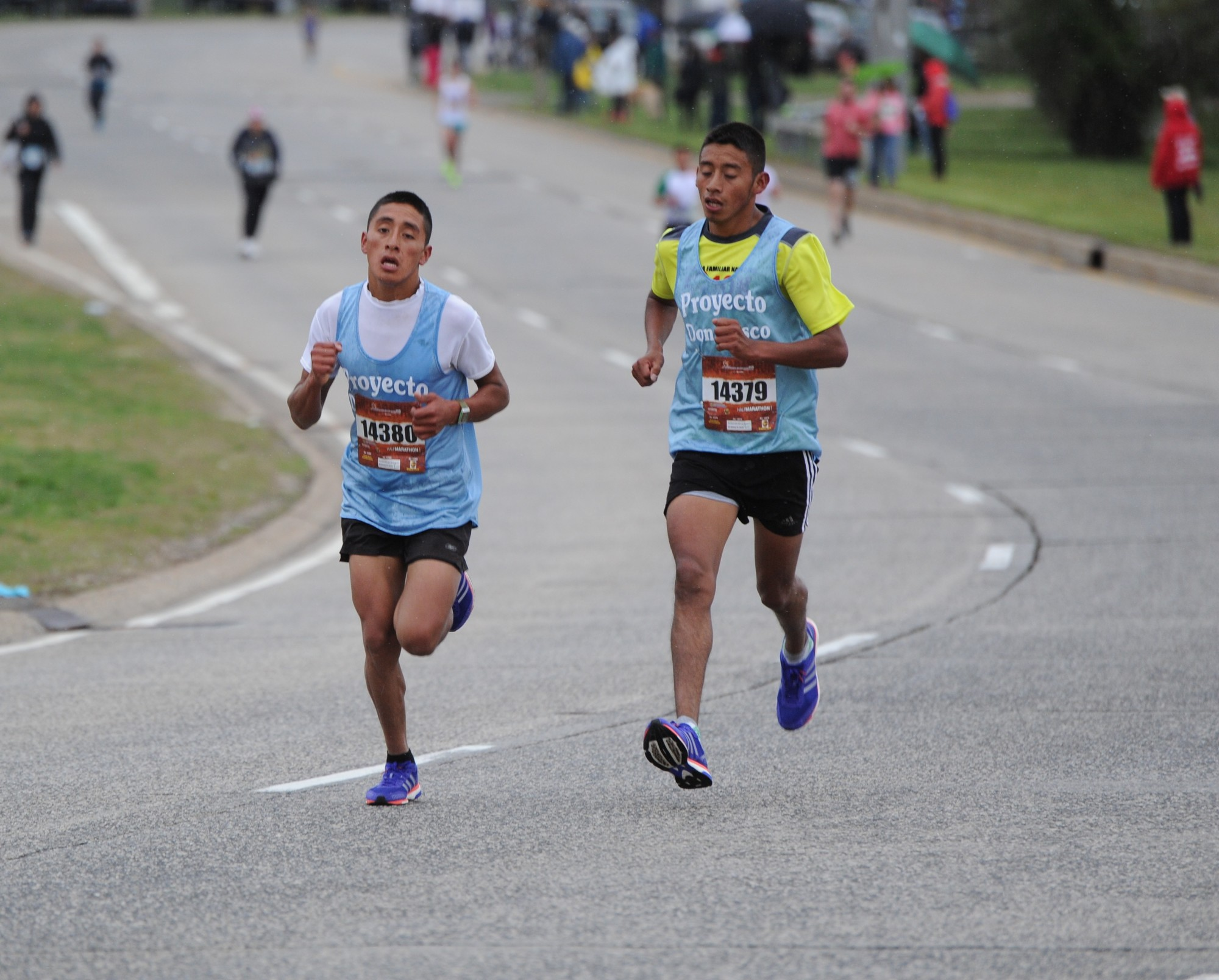 Brothers Wilson, left, and Erick Chavez Chox raced toward the finish line during last Sunday's half-marathon. Erick won the race, and Wilson finished second.