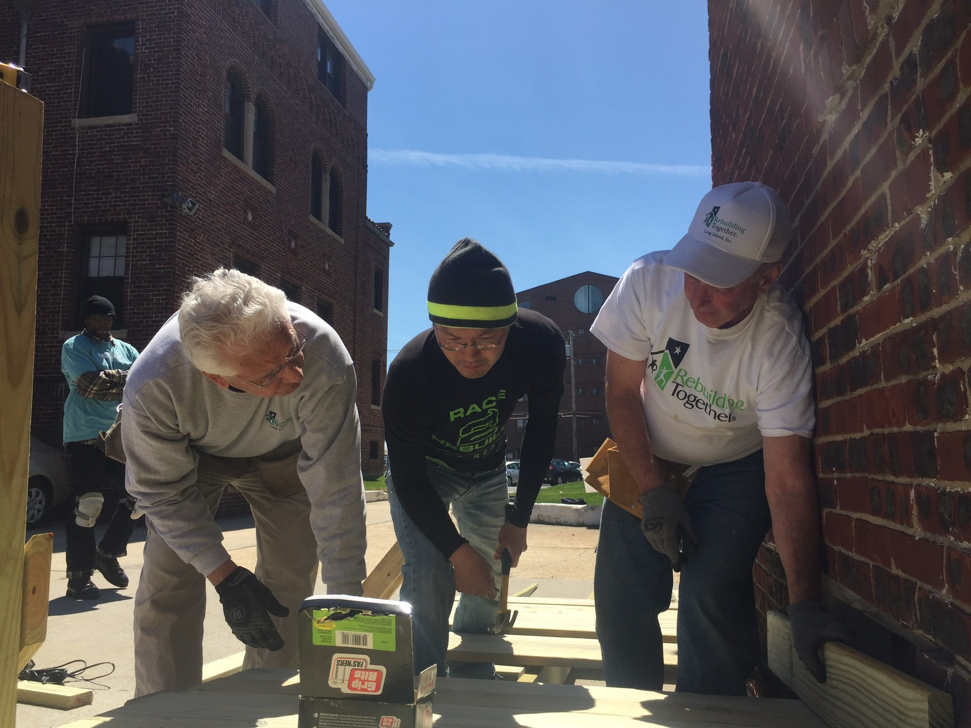 Volunteers worked on the installation of a wheelchair ramp at St. Ignatius Martyr Church as one of five projects last Saturday.