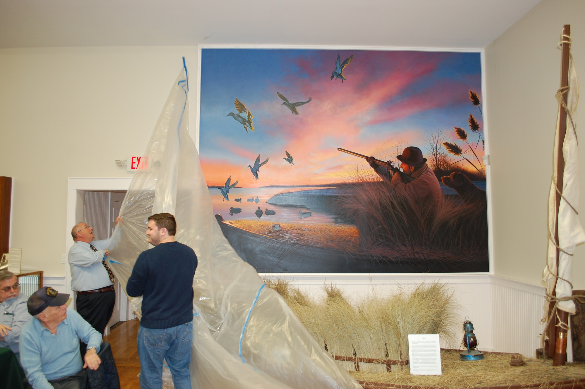 Historical Society officers Steve Bongiovi, left, and Patrick Martz unveiled the mural that depicts duck hunting in Seaford in the early 1900s.
