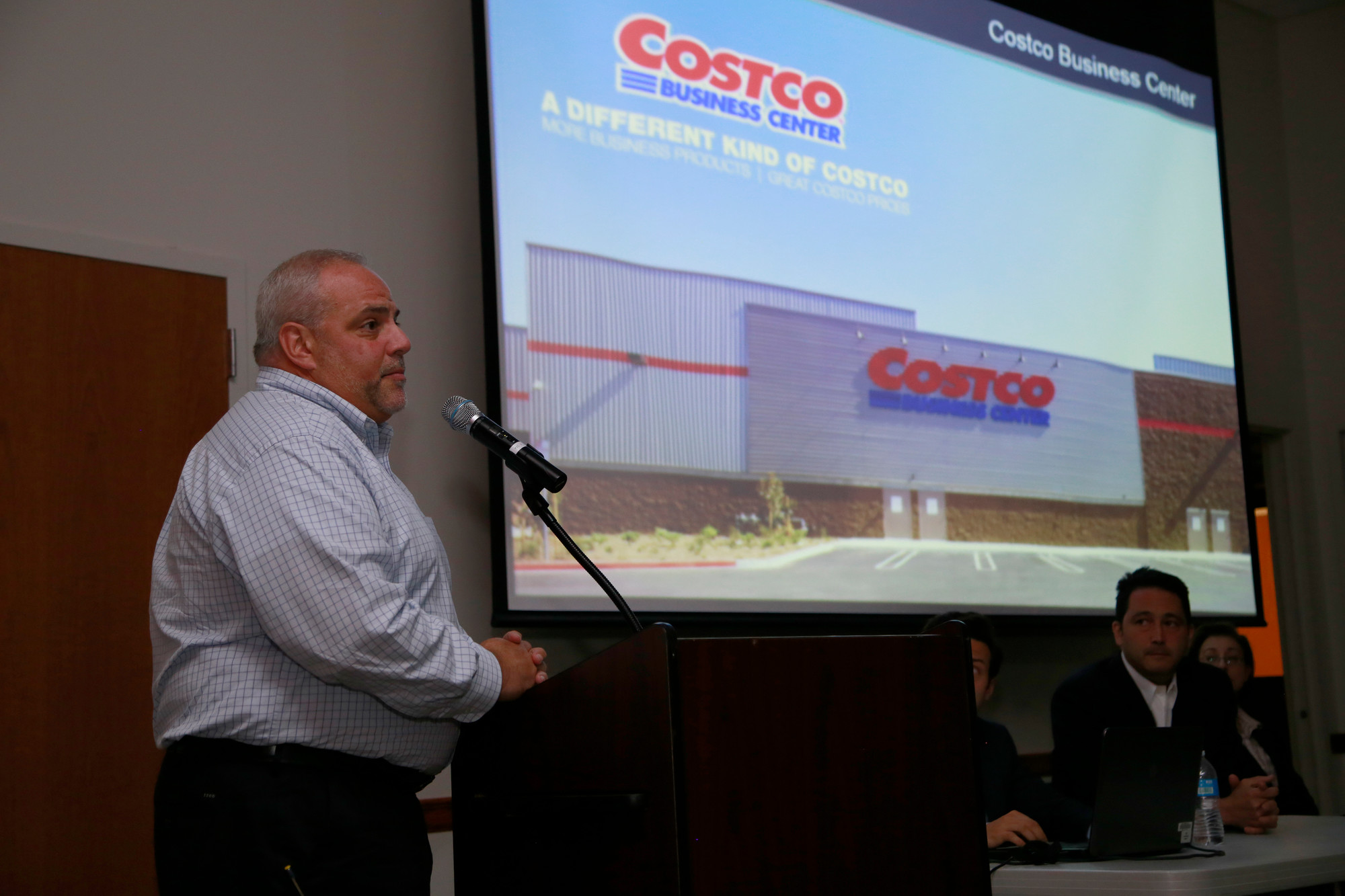 Joe Montesano, left, a representative of Costco, explained the impact that the retailer would have on the community.