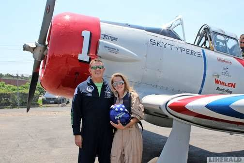 Pilot Larry Arken and Christina Daly after their flight.