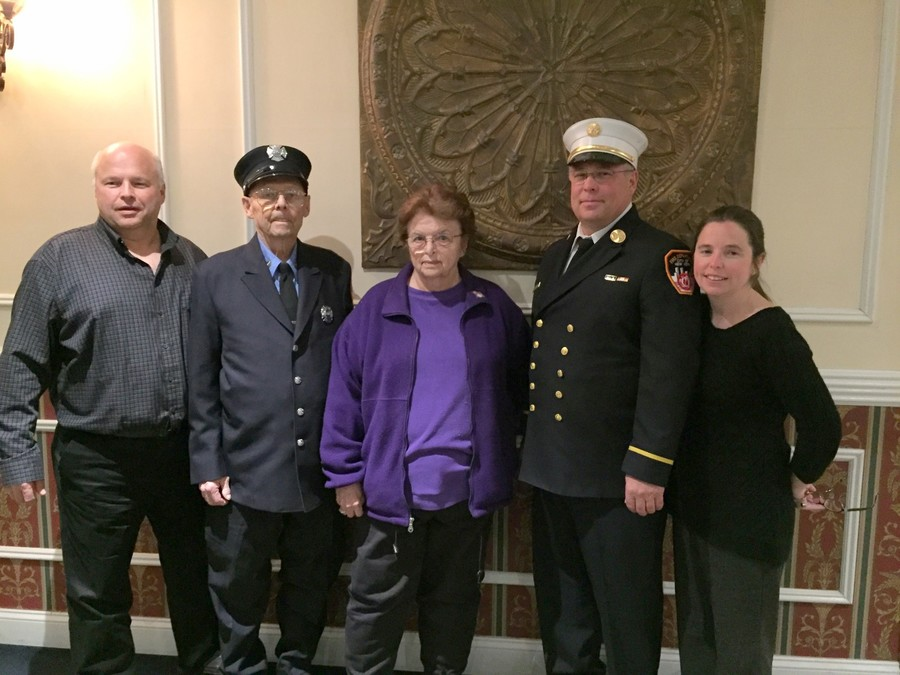 Dick Boll, second from left, with his son Richard E.; his wife, Elaine; his son Brian; and his daughter, Karen Dooling, on March 30 at his grandson Chris's graduation from the FDNY EMS academy.