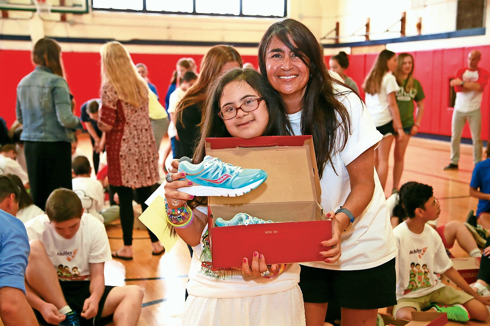 Teacher Carolyn Ferguson with Chastity Mackay and her new sneakers.