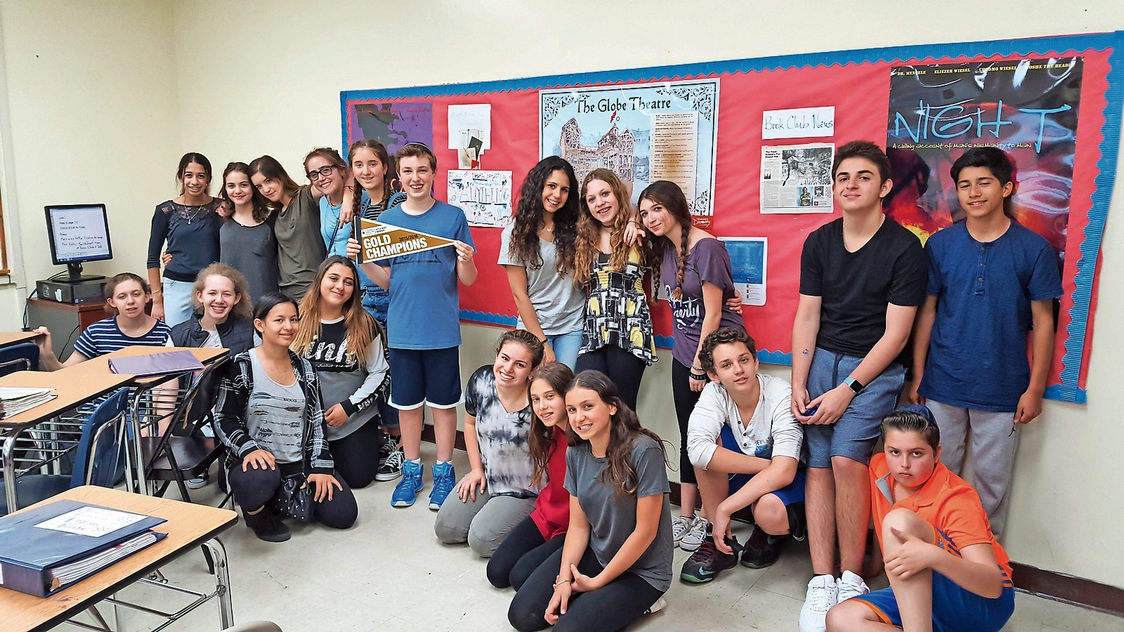The Brandeis School collected a school record $2,253.50 for the Leukemia & Lymphoma Society's Pennies for Patients program. Avi Nessim, holding pennant, with fellow eighth-graders. He raised  $1,843.50.