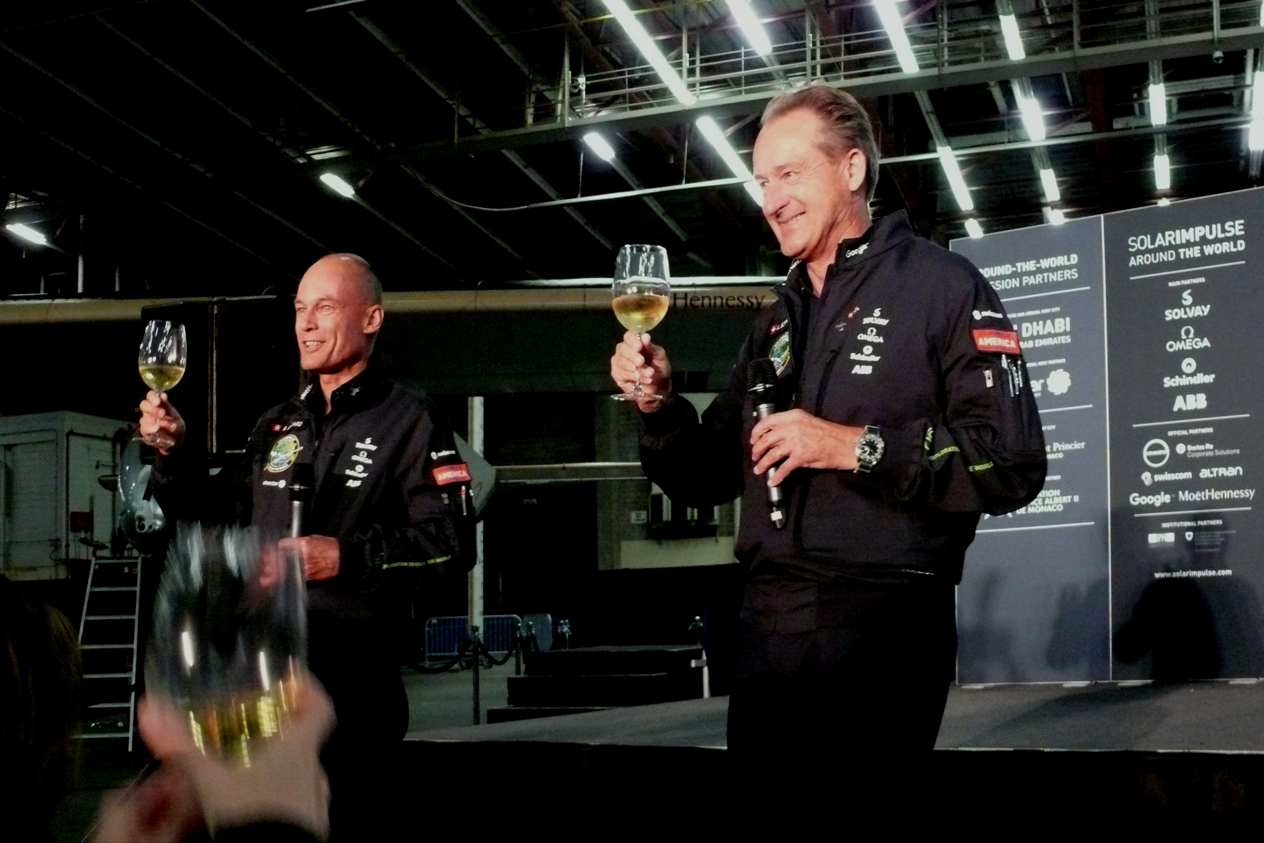 A toast to the next leg of their flight to Europe in the days ahead after the Solar Impulse 2 is powered up by the Sun at the airport.
