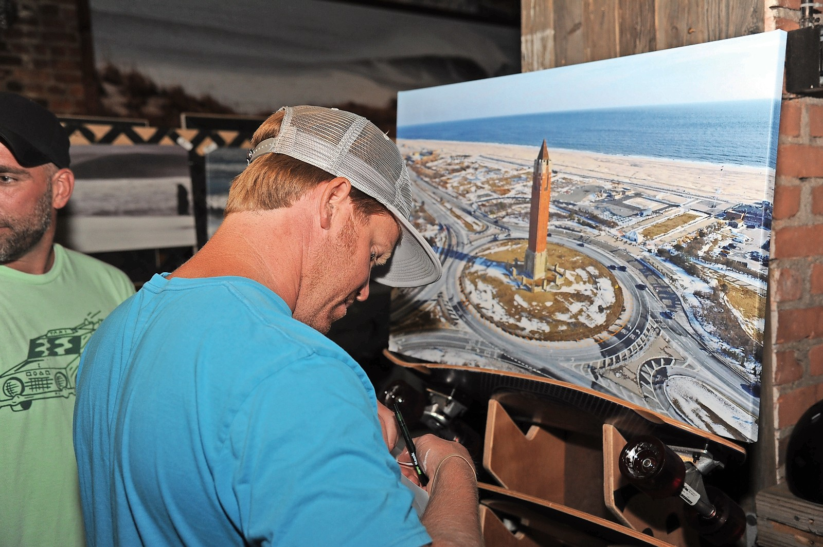 Skudin Surf and Surf for All co-founder Cliff Skudin priced an aerial image of Jones Beach at the event.