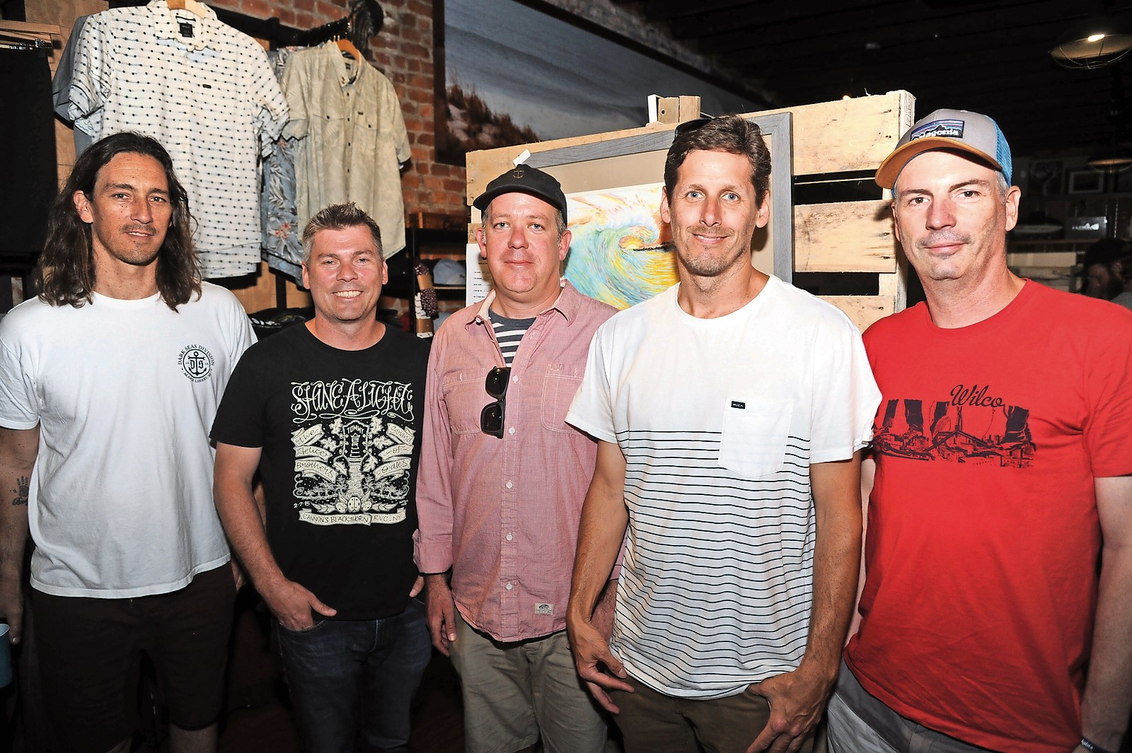 Unsound co-owner Dave Juan, far left, Tommy Brull Foundation co-founders Martin Brull and Keith Lucchesi, Unsound co-owner Mike Nelson, and foundation co-owner Dr. John Brull at Unsound's annual surf art show and auction on June 11.