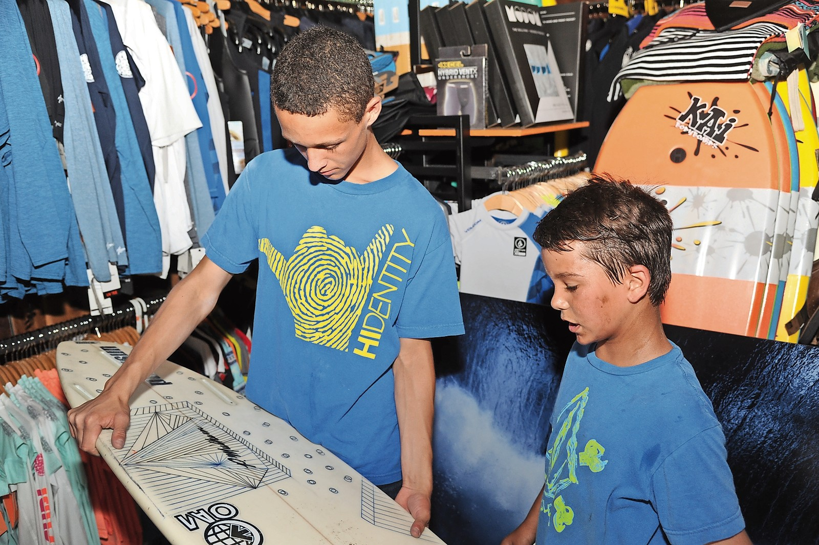 Ethan Grassini, 14, and Caleb Kallelis, 8, checked out a surfboard.
