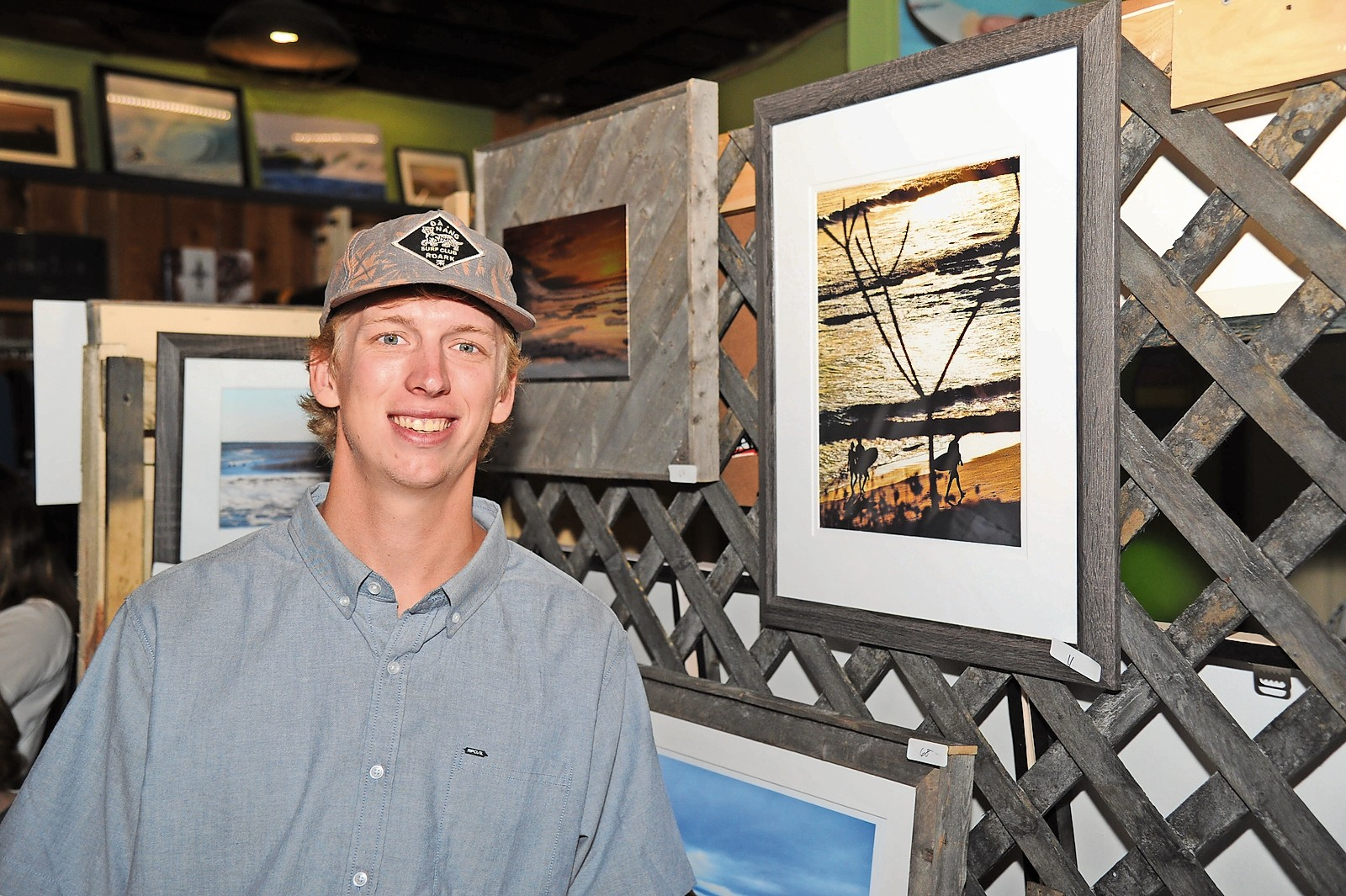 Artist Conor Barry, of Oceanside, and his photo of surfers in Nicaragua.