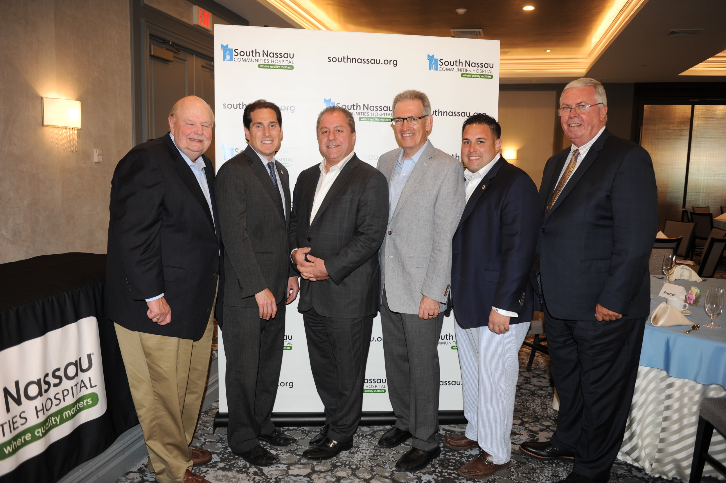 Joseph Fennessy, chairman of South Nassau Communities Hospital's board of directors, far left; State Sen. Todd Kaminsky; Butch Yamali, president of the Dover Group; Wayne Lipton, founder of Concierge Choice Physicians LLC; Town of Hempstead Councilman Anthony D'Esposito; and Richard J. Murphy, the hospital's president and CEO.