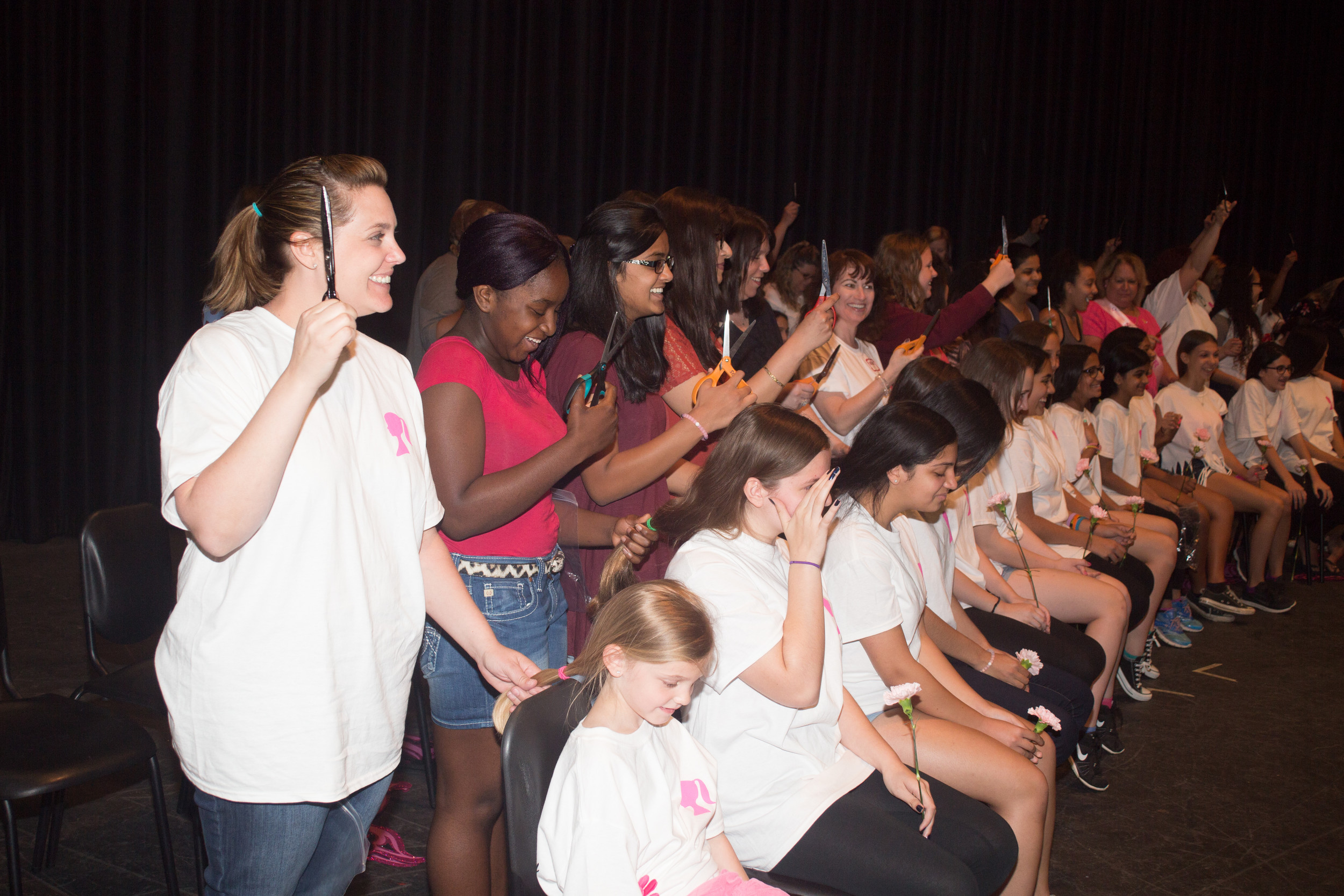 More than 50 Woodland students had their hair cut on June 13, as their ponytails were donated to the Pantene Beautiful Lengths program.