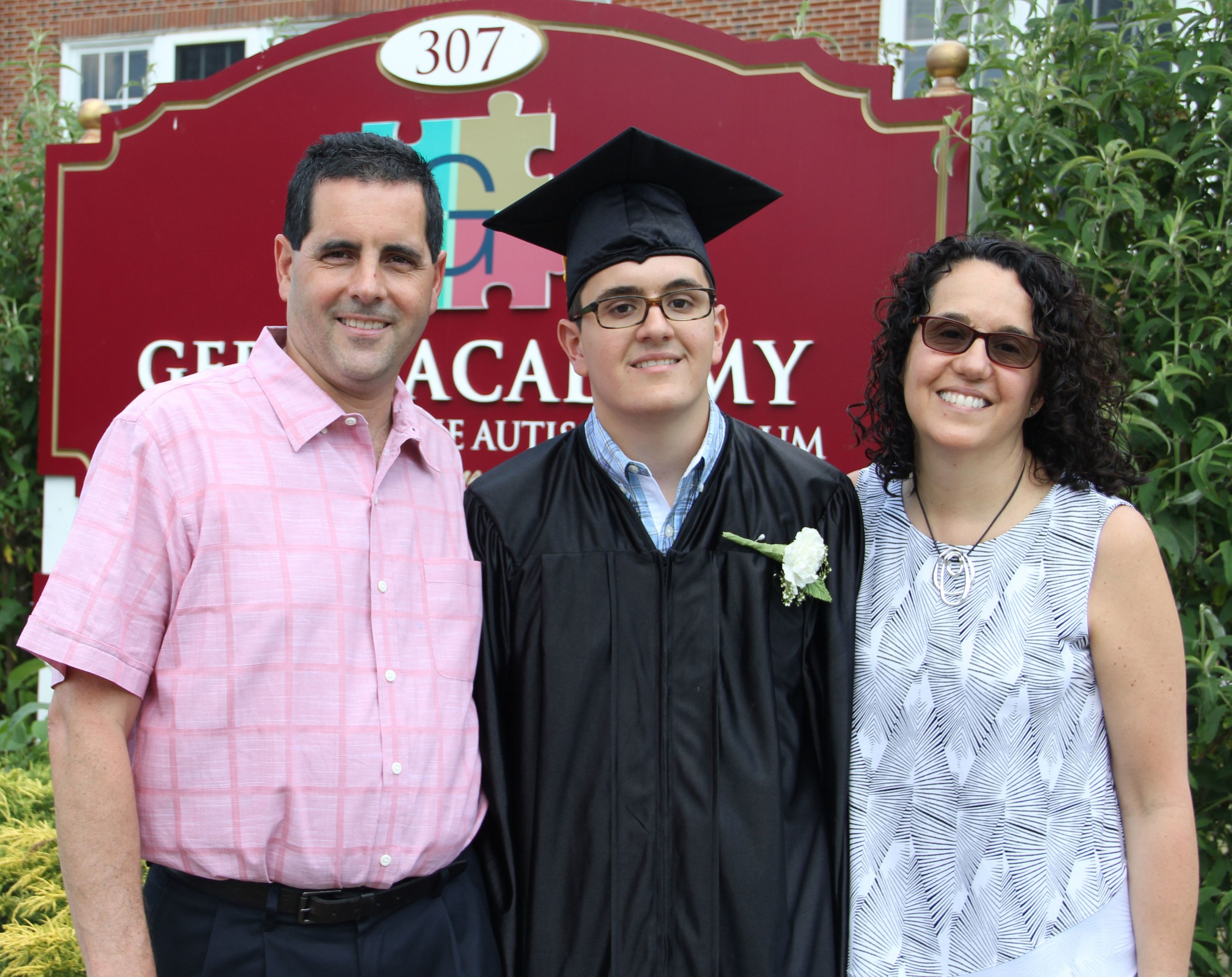 Matthew Hamilton, Gersh Academy graduate, is flanked by his parents, Susan and Larry Hamilton, after he received his high school diploma. The Franklin Square resident will go onto Adelphi in the fall.