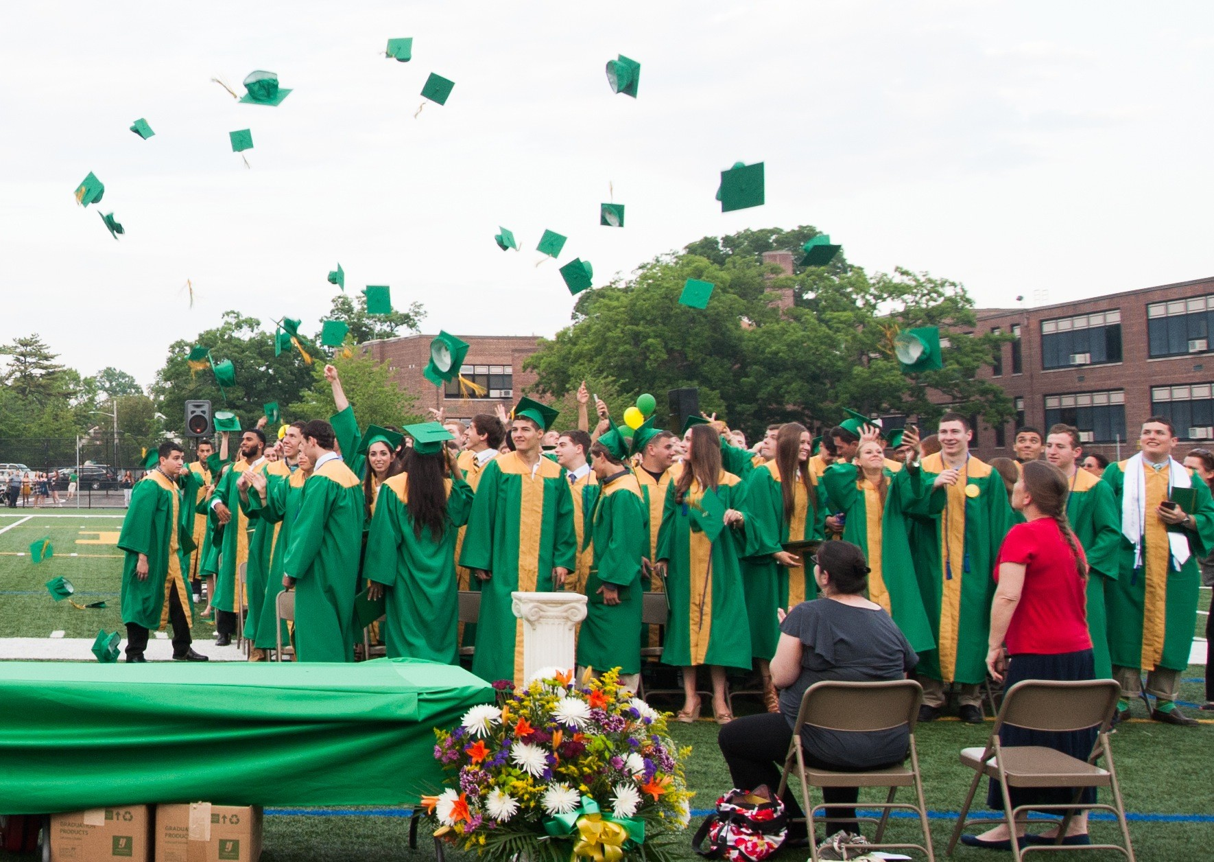 The Lynbrook High School class of 2016 celebrated their graduation by throwing their mortarboards in the air.