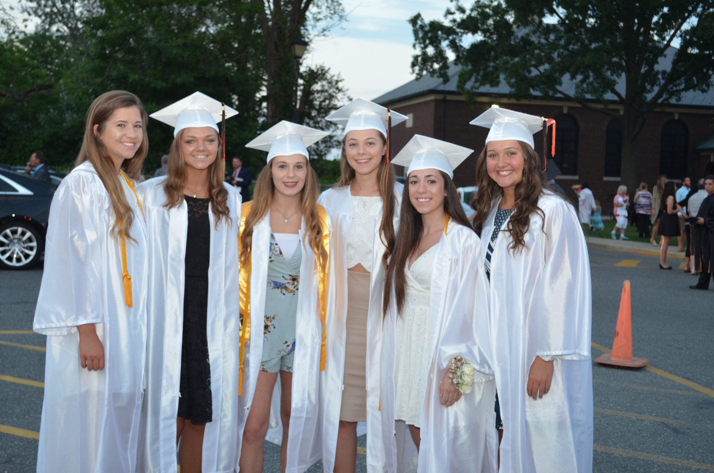 Graduates Rachael Putelo, Marisa Felbinger, Amanda Masterson, Erica Acampora, Samantha Bruzzo and Sydney O'Connor gathered for a photo outside of East Rockaway High School