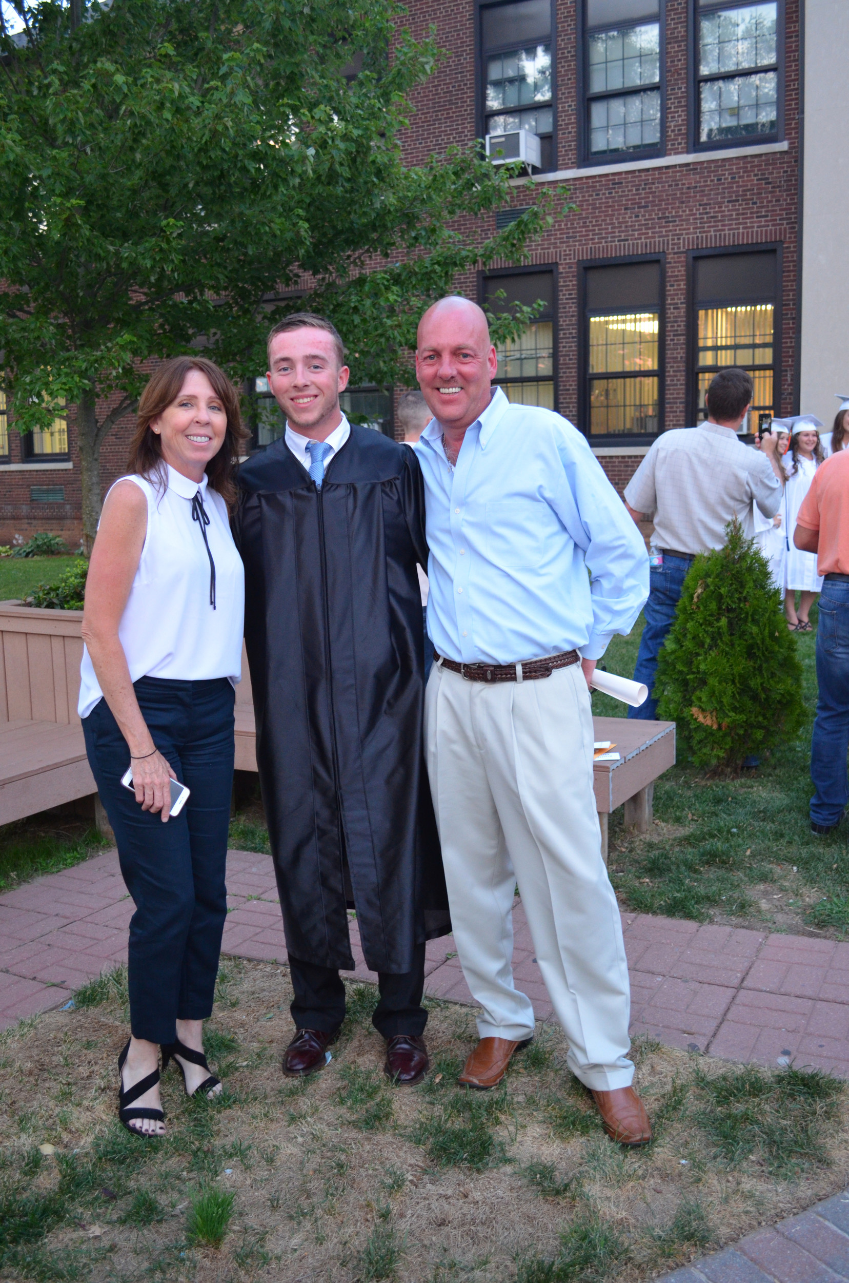 Graduate Ryan Kelly with his proud parents