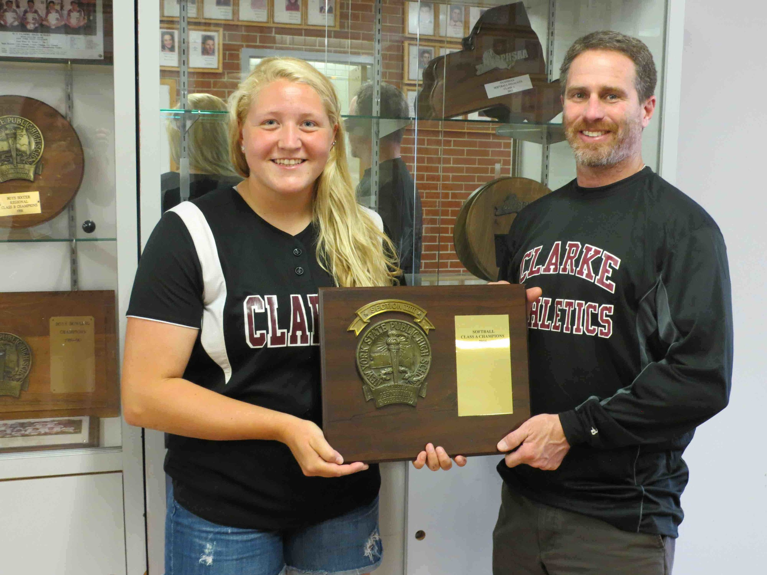 W.T. Clarke High School Athletic Director Joshua Friedman congratulated Sarah Cornell.