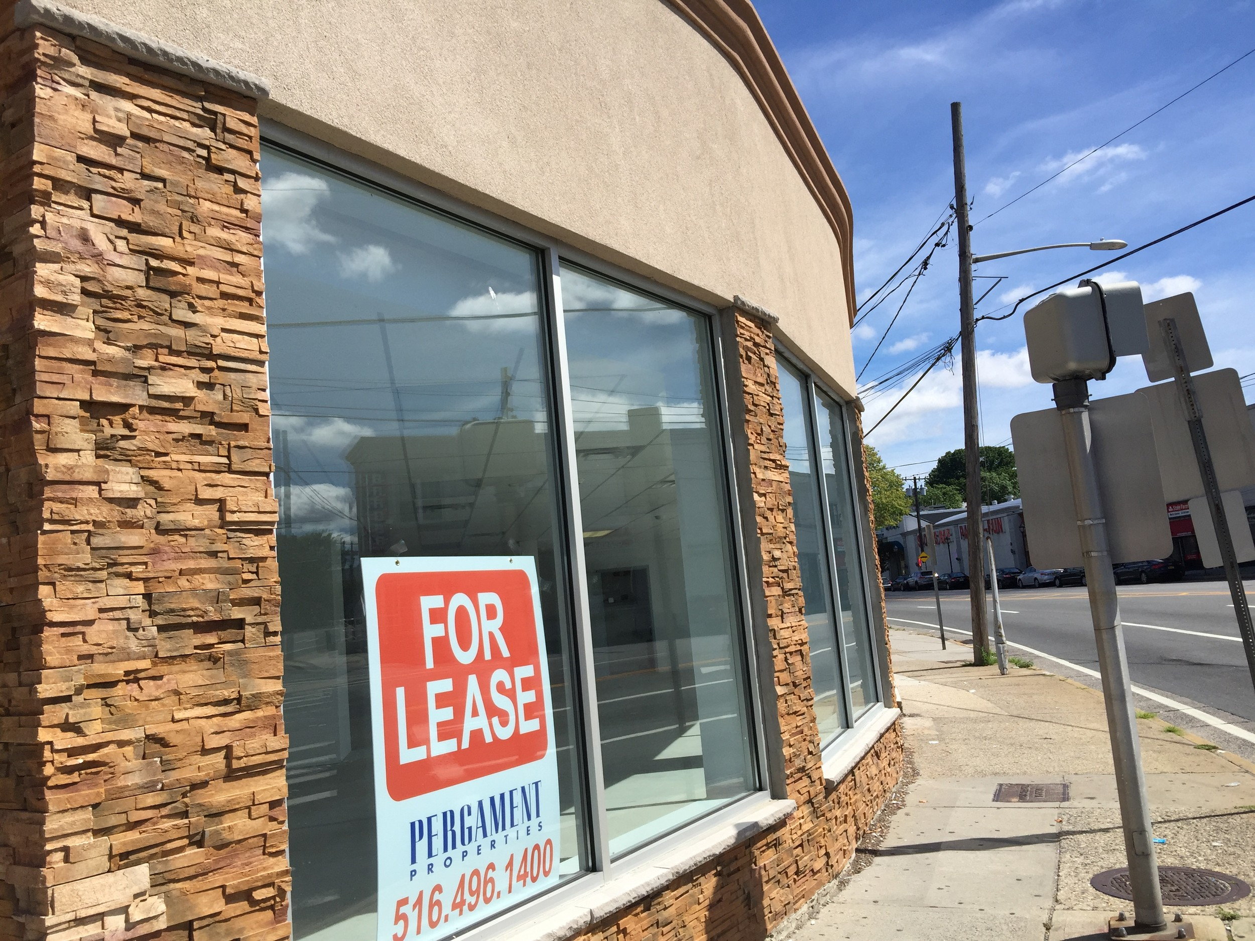 A storefront at the corner of Merrick Road and Grand Avenue is one of the many empty sites that are included in the redevelopment.