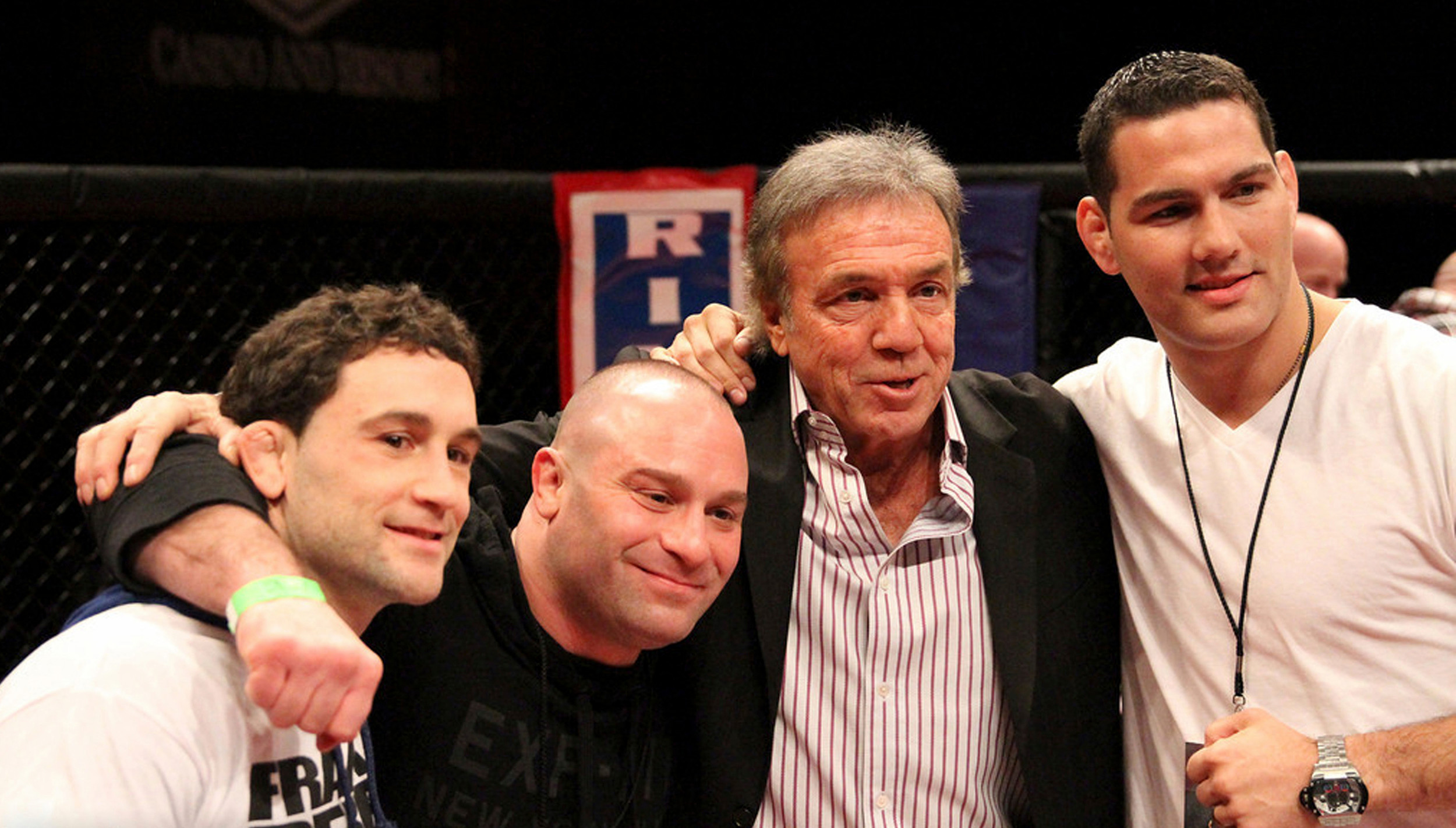 MMA promoter, Lou Negila, third from left, with former UFC champions Frankie Edgar, far left, Matt Serra, and Chris Weidman.