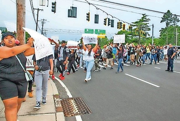More than 150 people recently took part in a Black Lives Matter rally in East Meadow to protest recent killings of African-American men by police in Louisiana and Minnesota.